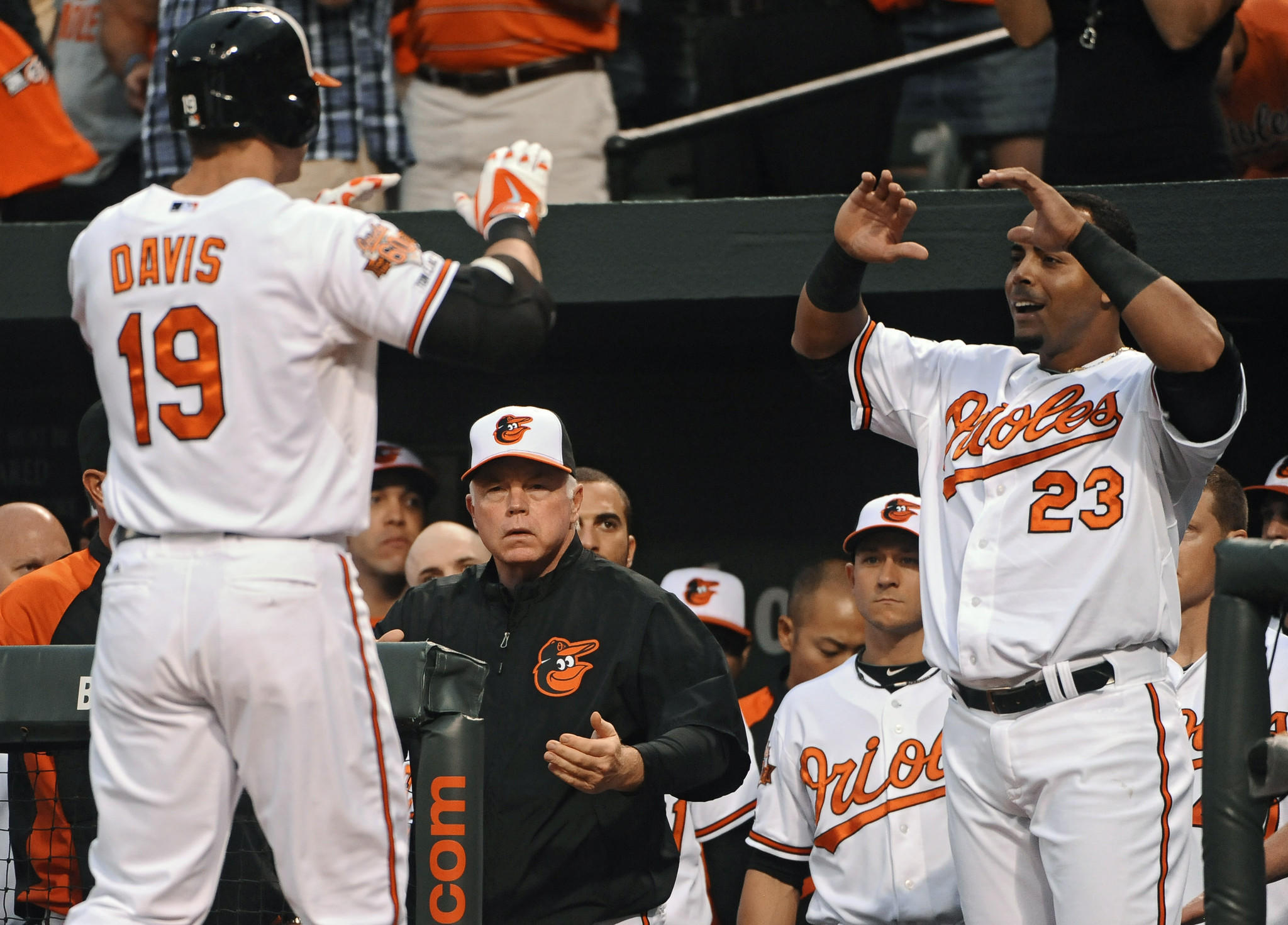 Orioles first baseman Chris Davis, left, receives congratulations from designated hitter Nelson Cruz after hitting a two-run home run in the first inning against the Boston Red Sox at Camden Yards.