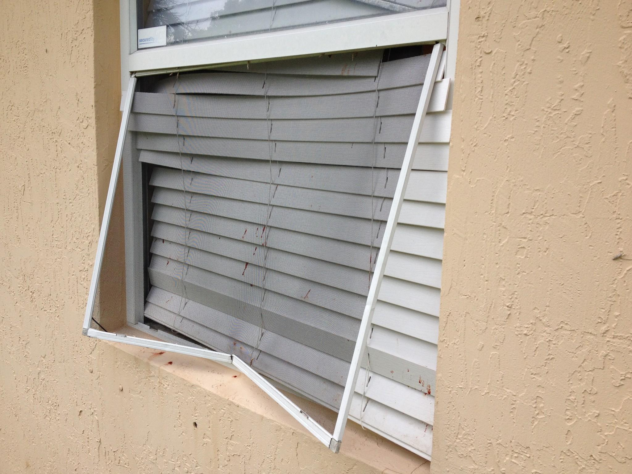A Miramar man climbed through this now blood-spattered window to escape violent robbers who invaded his home.