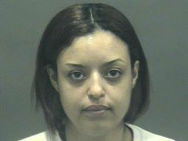Madeline Roque, 33, of New Haven, is charged with assaulting her ex-boyfriend with a frying pan, hot oil and pork chops.