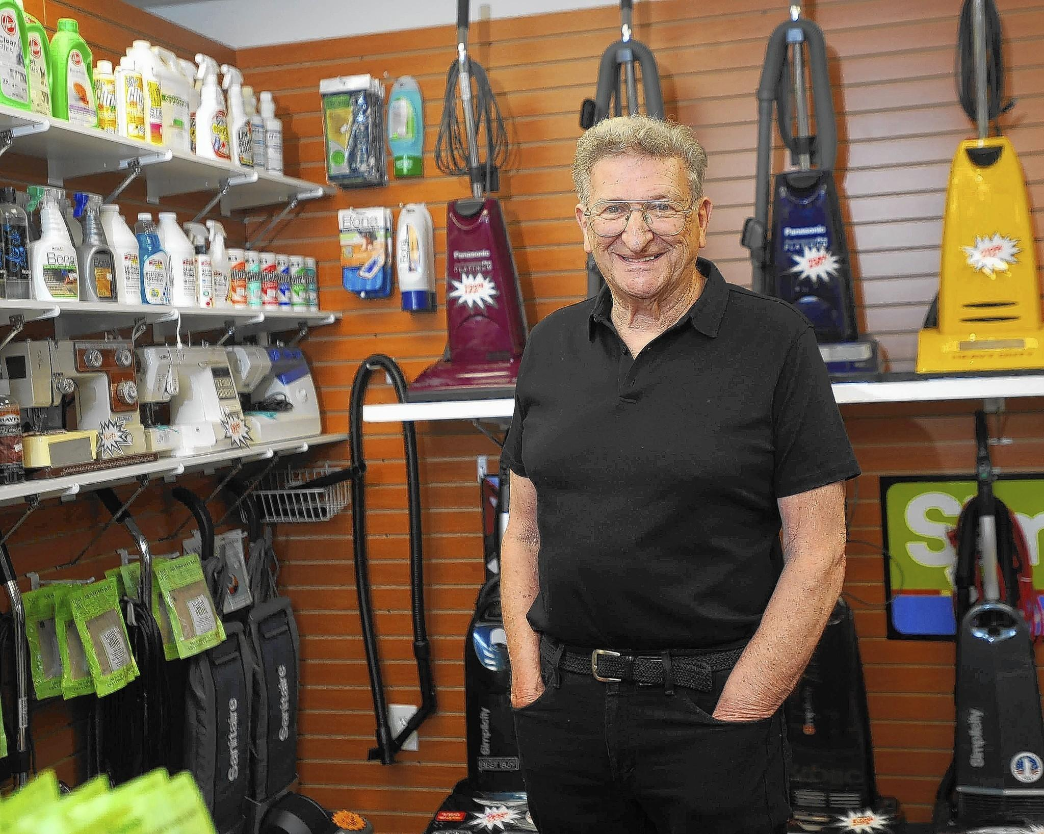 Morris Weiner, 80, is all smiles as he stands in Weiner's Vacs, the store on Reisterstown Road where he has sold and repaired vacuum cleaners for 44 years. These days Weiner is assisted by his daughter, Jeri Cuffley, who has been working in the busniness for 25 years.