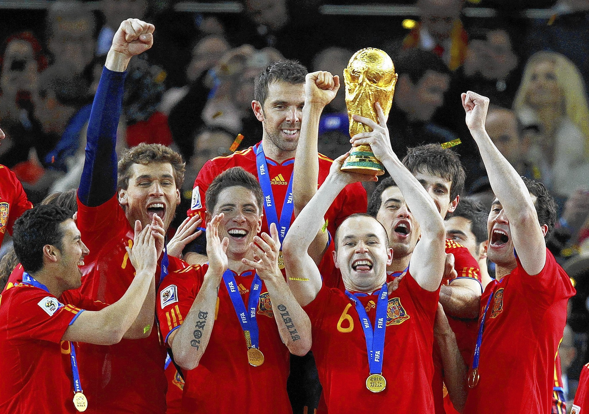 Spain's Andres Iniesta holds the World Cup trophy after the 2010 World Cup final soccer match between Netherlands and Spain at Soccer City stadium in Johannesburg July 11, 2010.