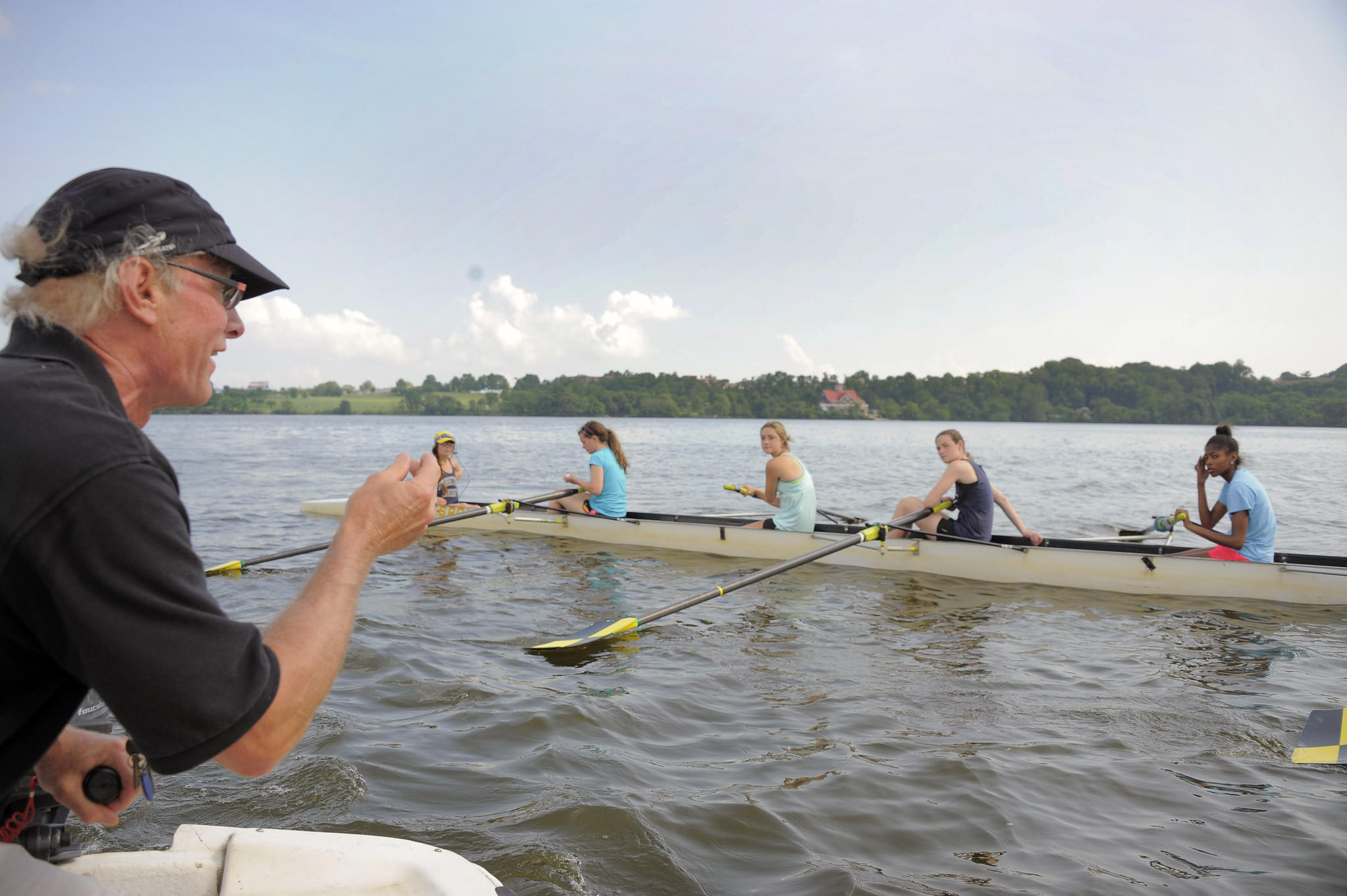 Youth rowing director Judd Anderson instructs during a Baltimore Rowing Club practice on the middle branch of the Patapsco River on Tuesday.