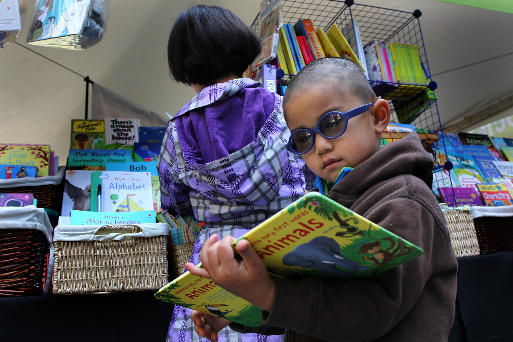 Cyrus Di, 4, along with his sister Cynthia, 10, and their parents check out Usborne Books & More at Printers Row Lit Fest.
