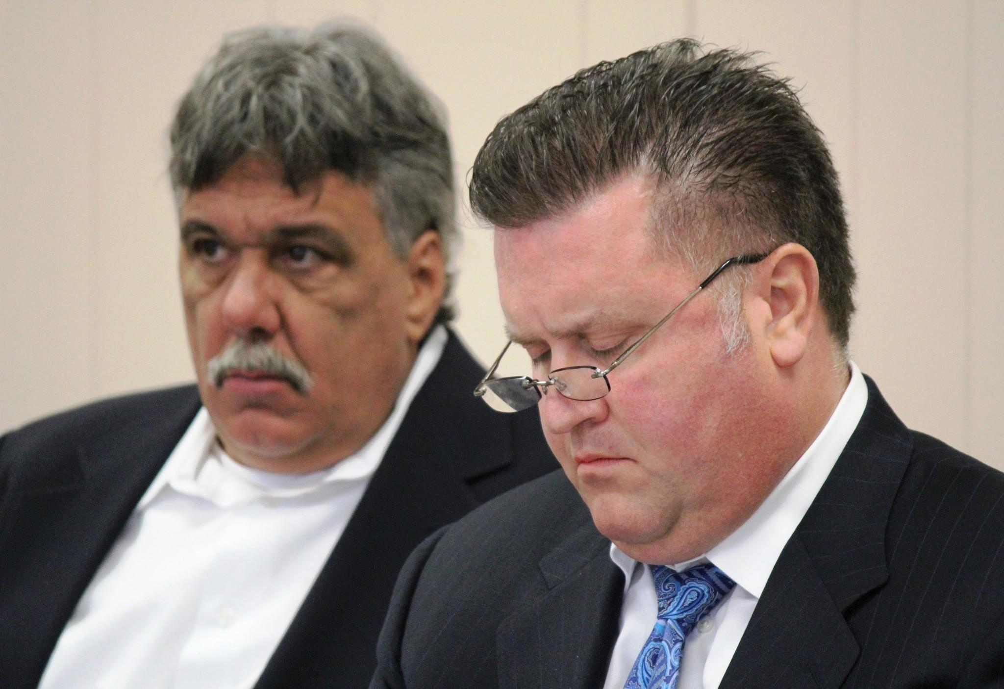 Ronald Pieri, left, and his lawyer, Richard Blass, at hearing Monday before the Highwood police and fire commission.