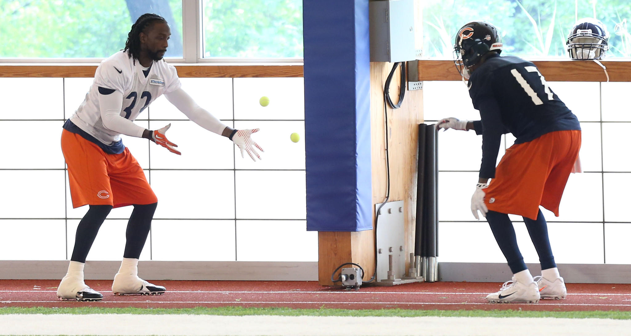Charles Tillman (left) and Alshon Jeffrey do agility Wednesday at Halas Hall.