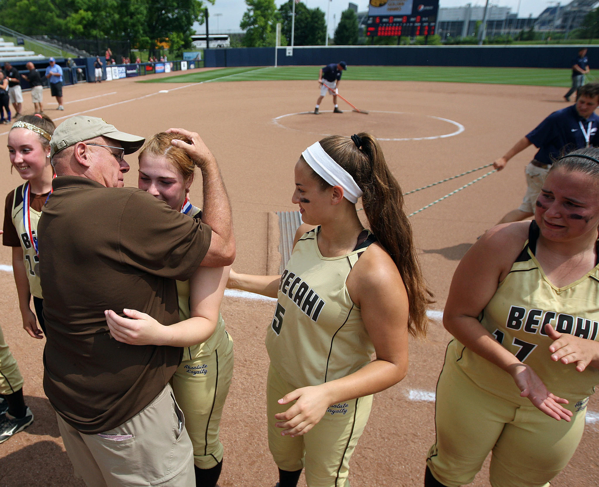 Bethlehem Catholic head coach Rich Mazza, hugs Elyse Cuttic (14) after giving a second place medal to her, after losing 3-0 to Springfield-Delco's , in the PIAA 3A Softball Championships Friday June 13, 2014 at Beard Field on the campus of Penn State University. //////CHRIS KNIGHT / SPECIAL TO THE MORNING CALL
