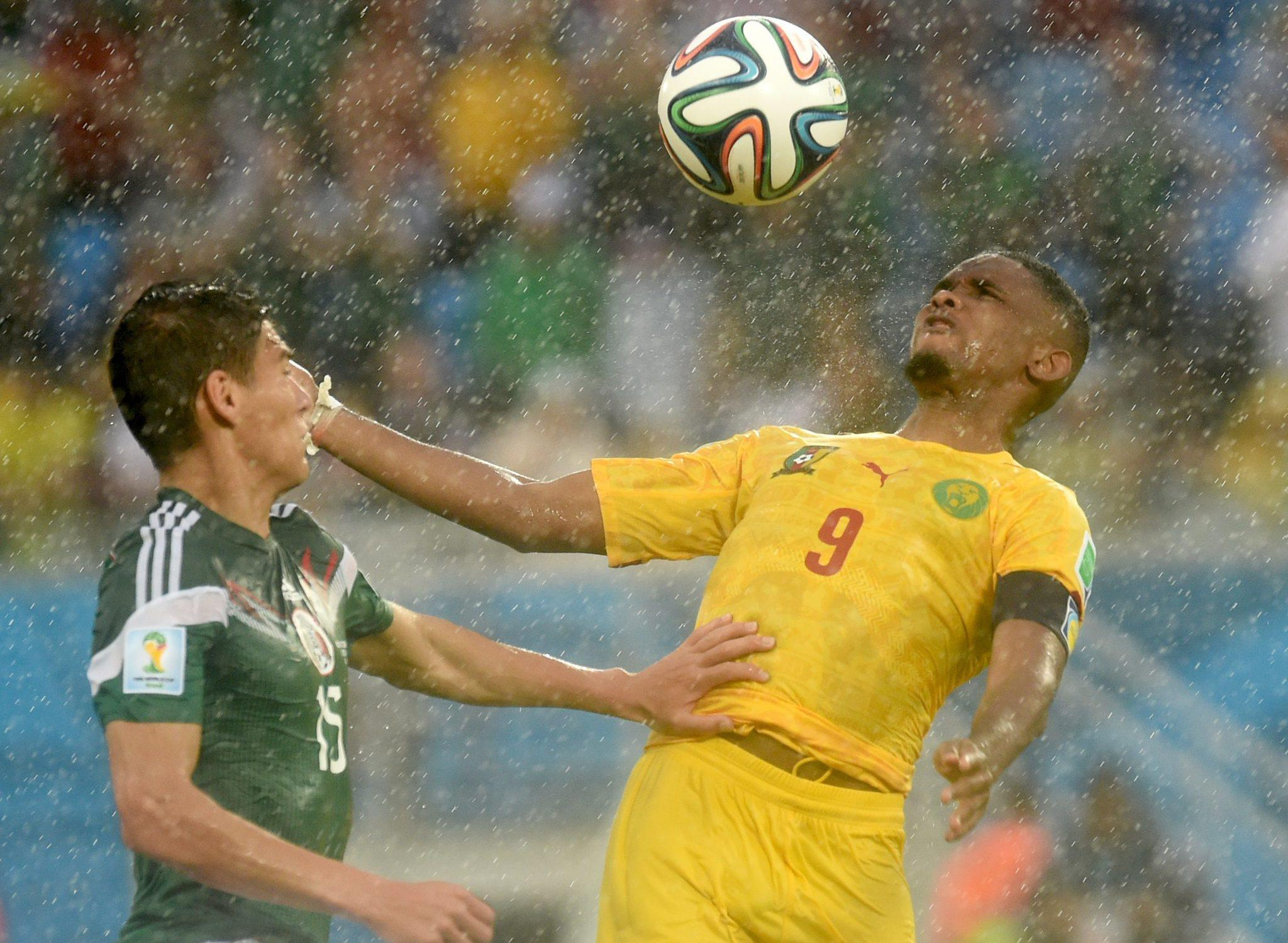 Hector Moreno (left) of Mexico vies with Samuel Eto'o of Cameroon during Friday's World Cup game.