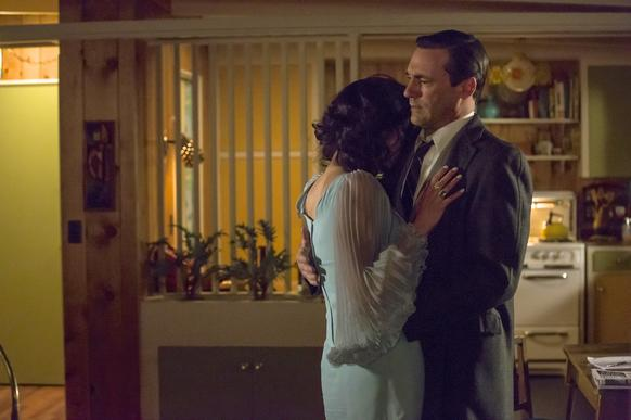 Don Draper (Jon Hamm) and Megan Draper (Jessica Pare) embrace in a time of reflection.