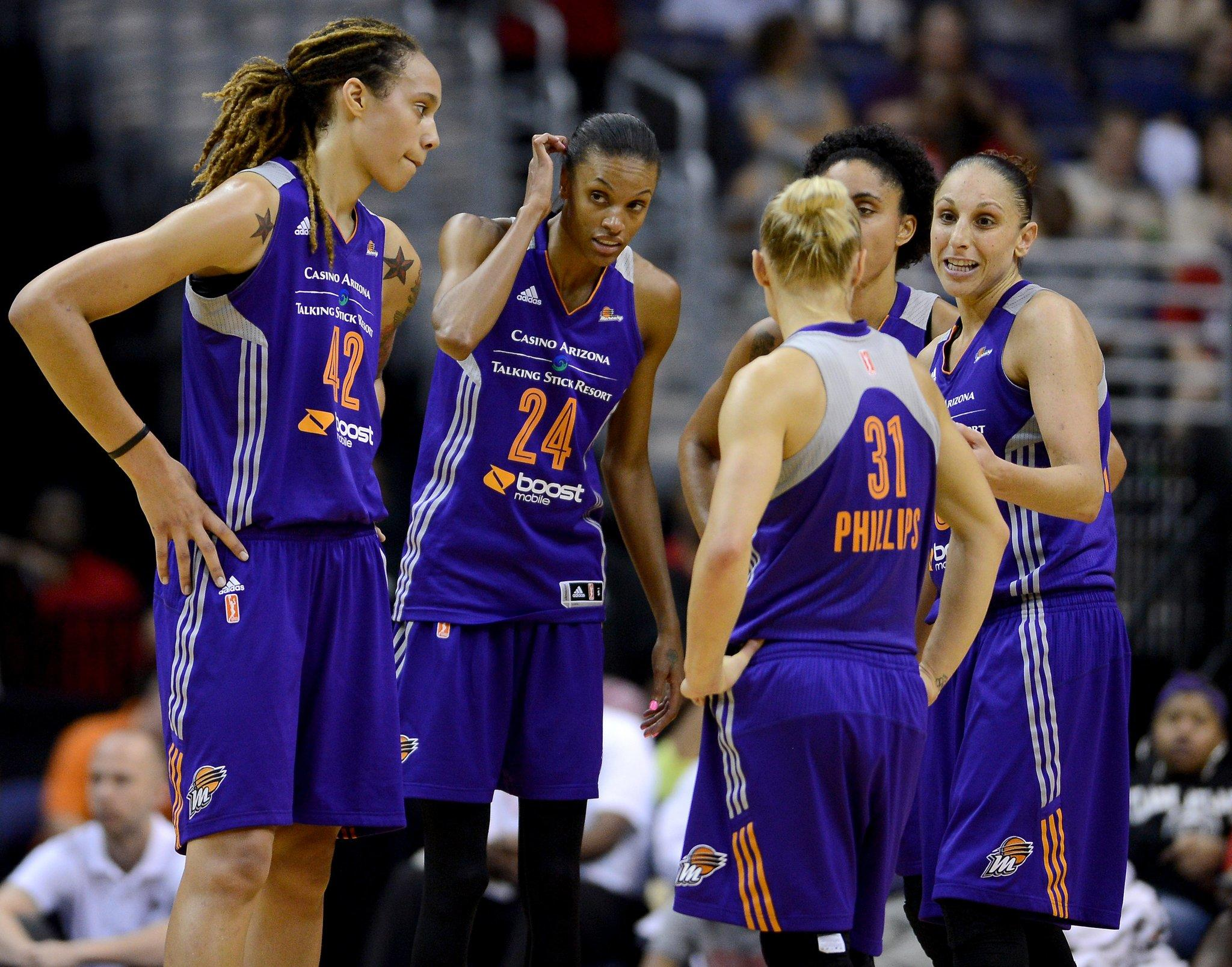 Phoenix Mercury guard Diana Taurasi (3), right, speaks with teammates, Mercury center Brittney Griner (42), Mercury forward DeWanna Bonner (24), Mercury forward Candice Dupree (4) and Mercury guard Erin Phillips (31), during a timeout in the fourth quarter against the Washington Mystics at the Verizon Center in Washington, Tuesday, June 10, 2014. The Mercury defeated the Mystics, 81-66. (Chuck Myers/MCT)