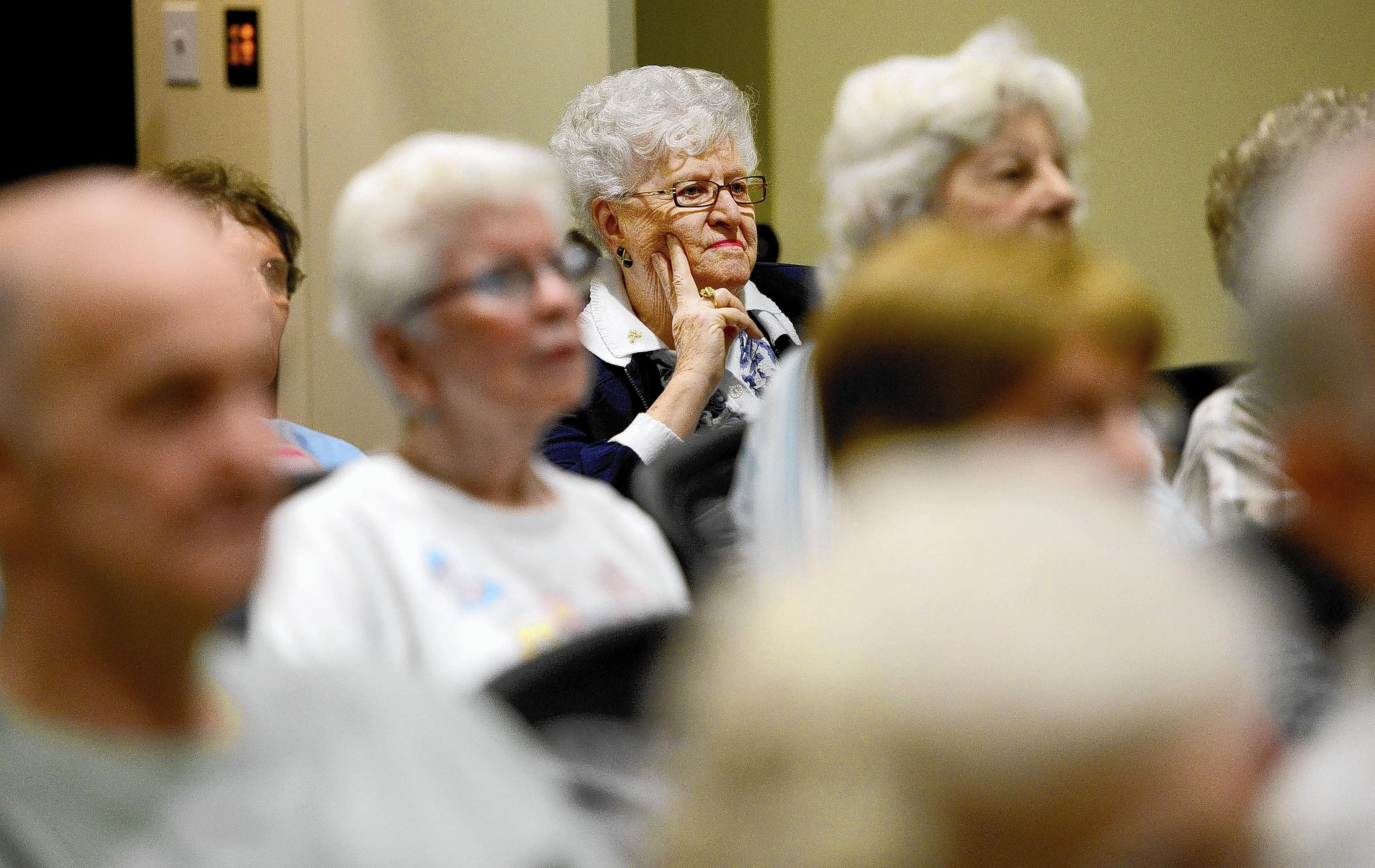 Covenant Village of Florida resident Alva Sommers, of Plantation, and others listen to a lecture from a Nova Southeastern University adjunct professor.