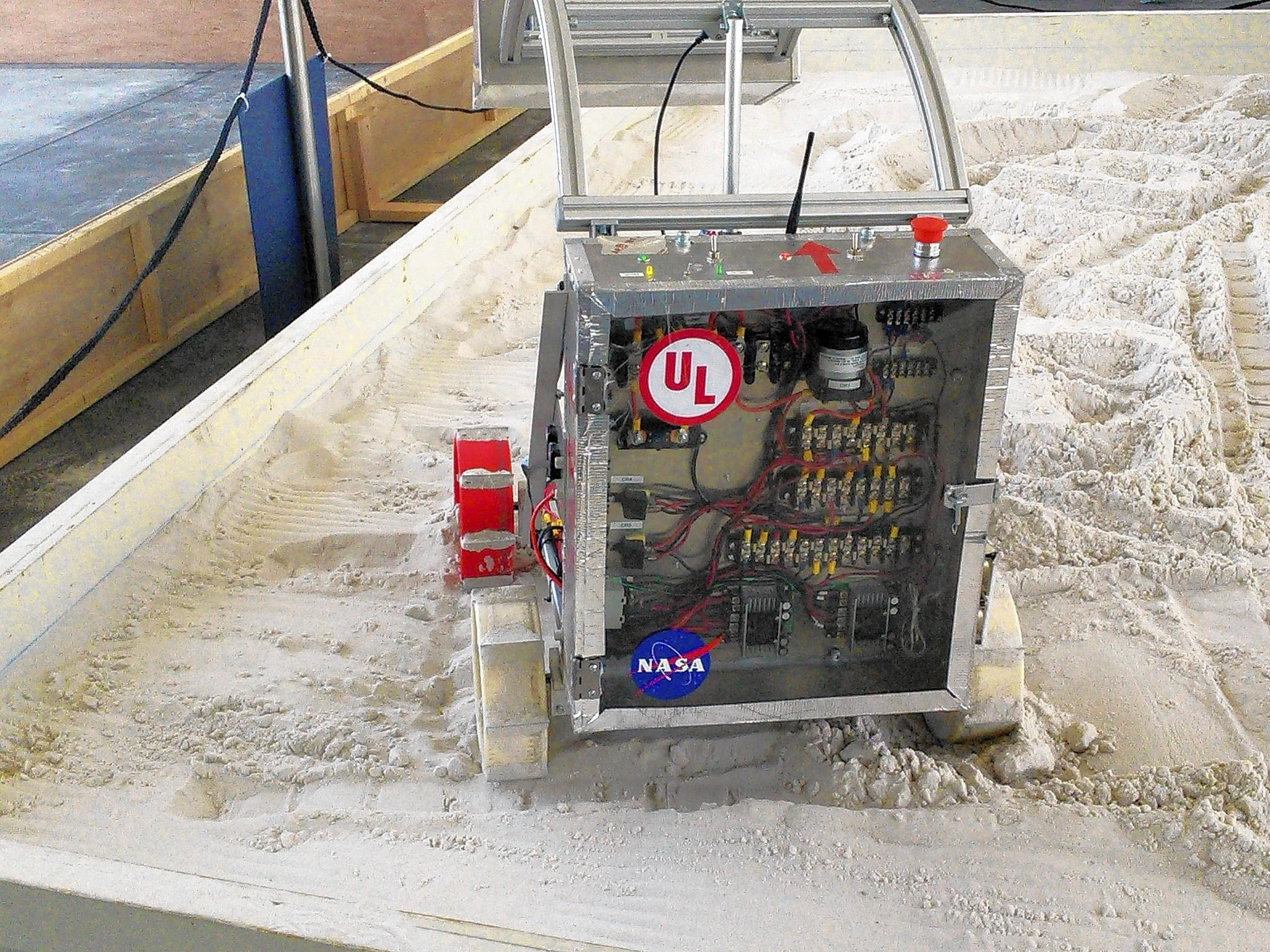 """""""Oaktimus Prime,"""" a remote-controlled excavator designed by students at Oakton Community College, competed at the annual NASA Robotic Mining Competition in Florida."""