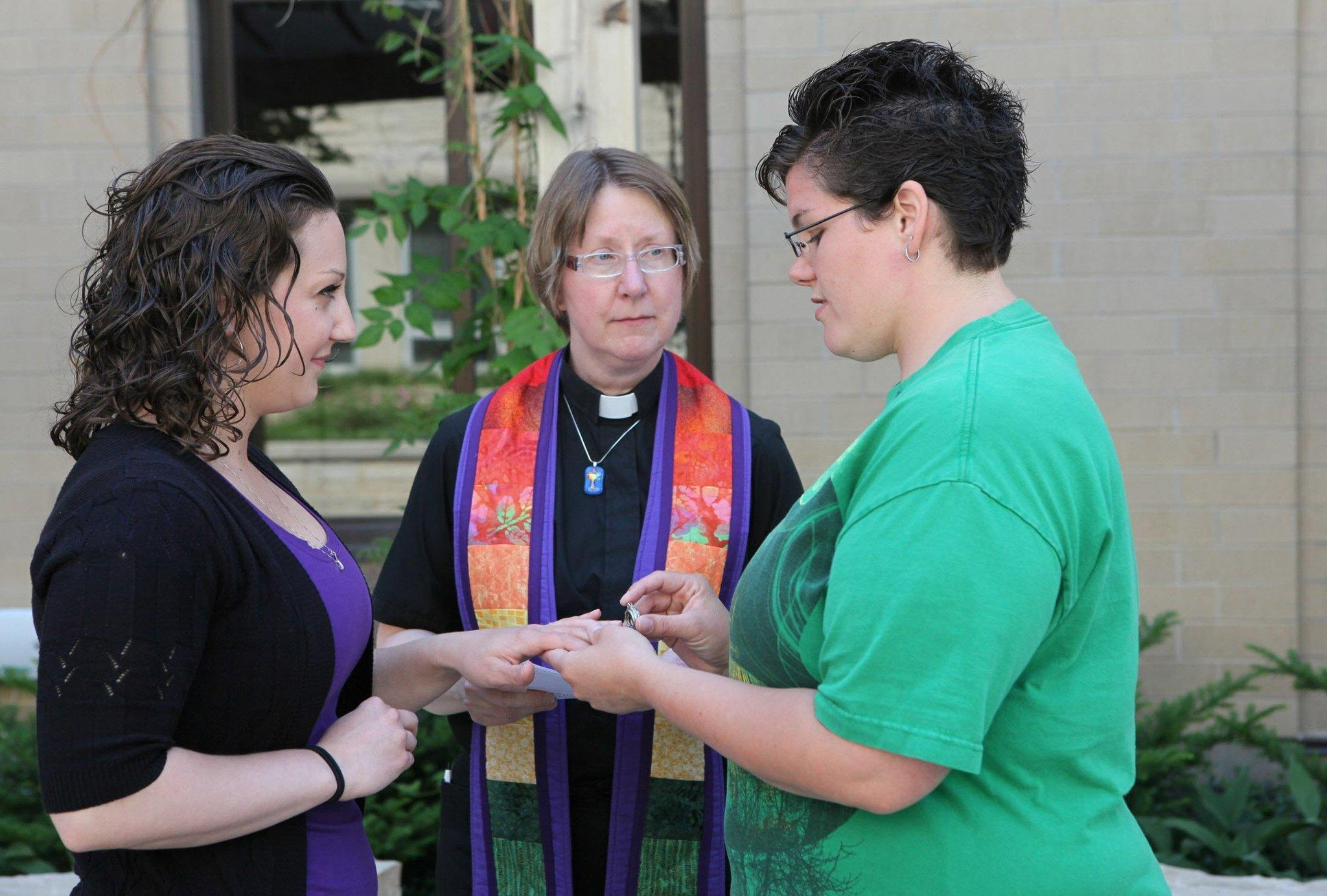 Courtney Beckwith, left, and Amber Beckwith are married by Rev. Lori Hlaban on June 9, 2014, in Waukesha, Wisc. The couple had their names changed legally after an earlier commitment ceremony.