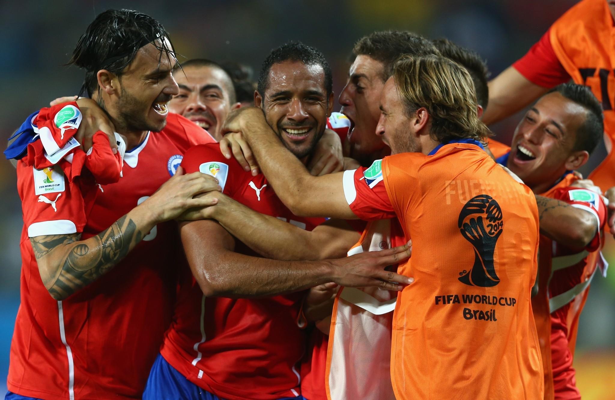 Jean Beausejour of Chile (C) celebrates scoring his team's third goa.