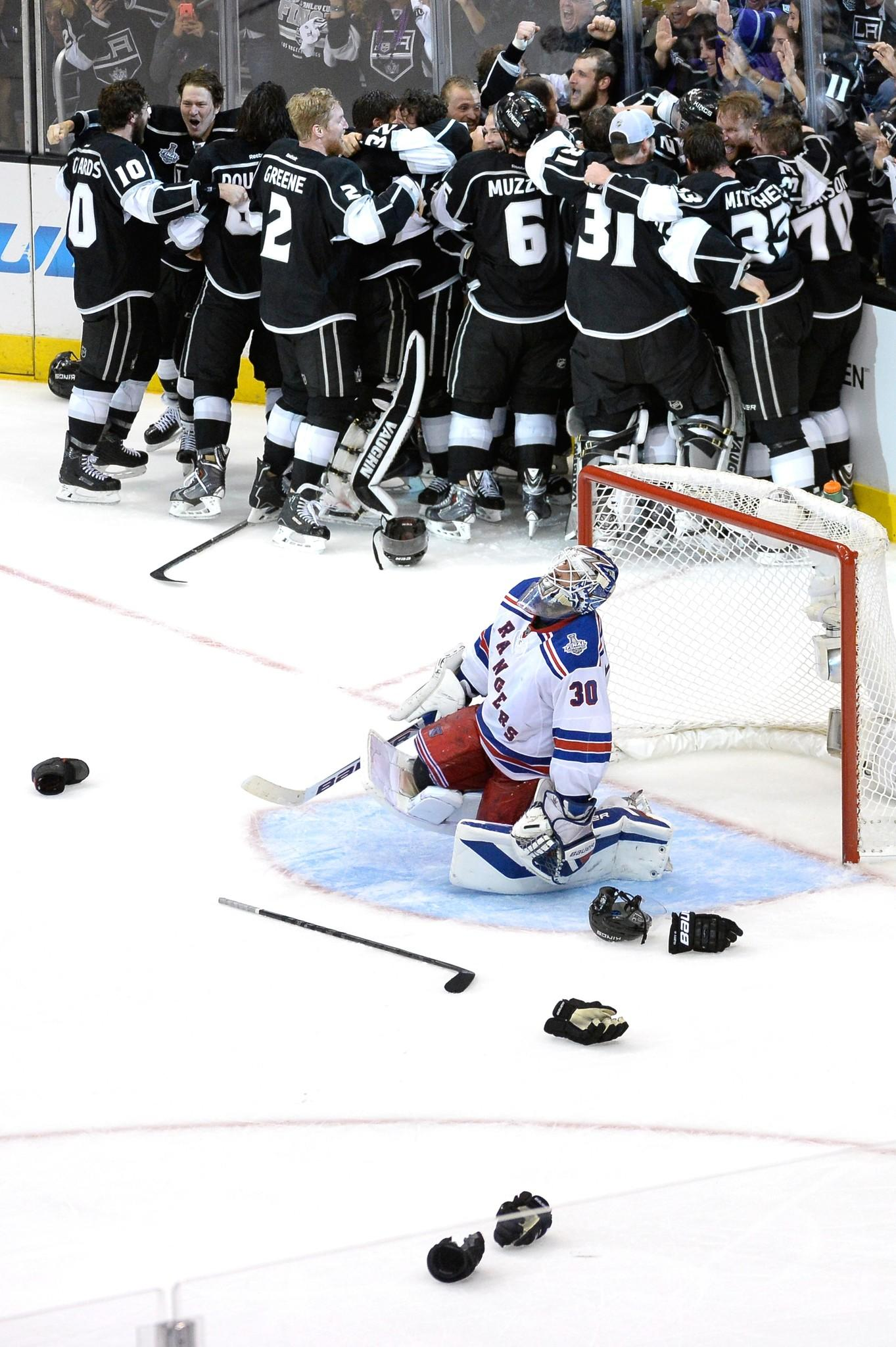 Alec Martinez and the Kings celebrate after scoring the game-winning goal in double overtime.