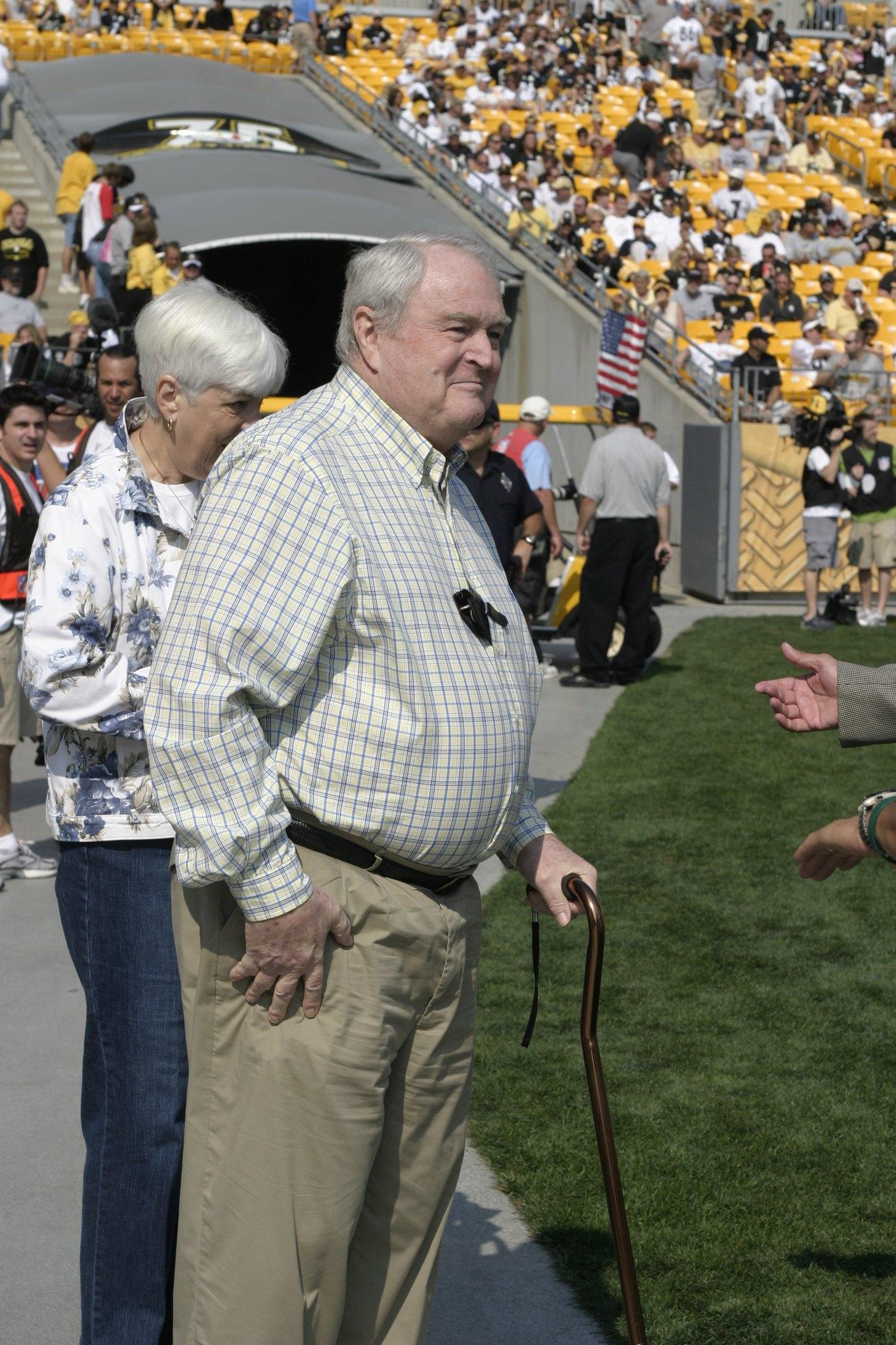 Chuck Noll, former head coach of the Pittsburgh Steelers, and his wife Marianne, look on from the sideline before a game between the Steelers and Seattle Seahawks at Heinz Field on October 7, 2007 in Pittsburgh, Pennsylvania.