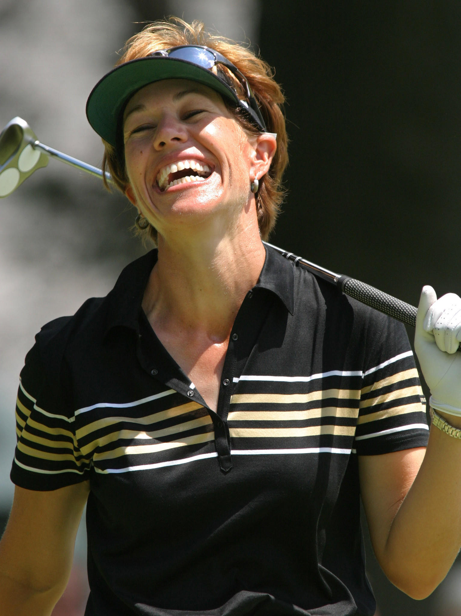 Suzy Whaley shares a laugh with her playing partners on her second and final day of competition at the Greater Hartford Open, July 25, 2003 in Cromwell, Connecticut. Whaley failed to qualify for continued competition after shooting rounds of 75 and 78 for a combined score of 13-over-par for the two days. REUTERS/Jim Bourg ORG XMIT: CRW13Dz