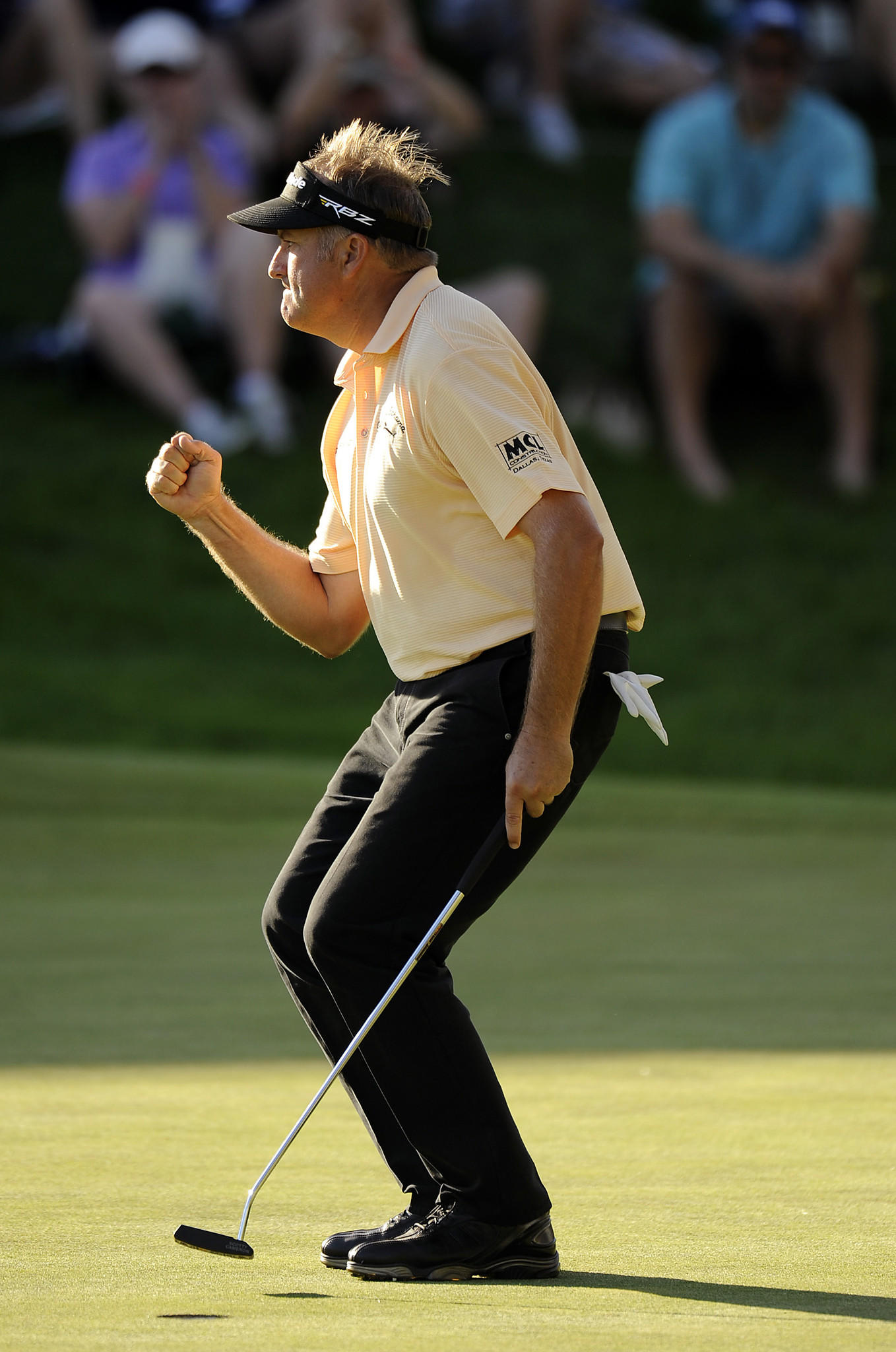 """Cromwell, CT 6/21/13 Ken Duke pumps his fist after sinking his winning putt from 2' 9"""" on the 18th green during the second playoff hole with Chris Stroud during the Final round of the 2013 Travelers Championship at the TPC River Highlands in Cromwell Sunday. Photo by JOHN WOIKE 