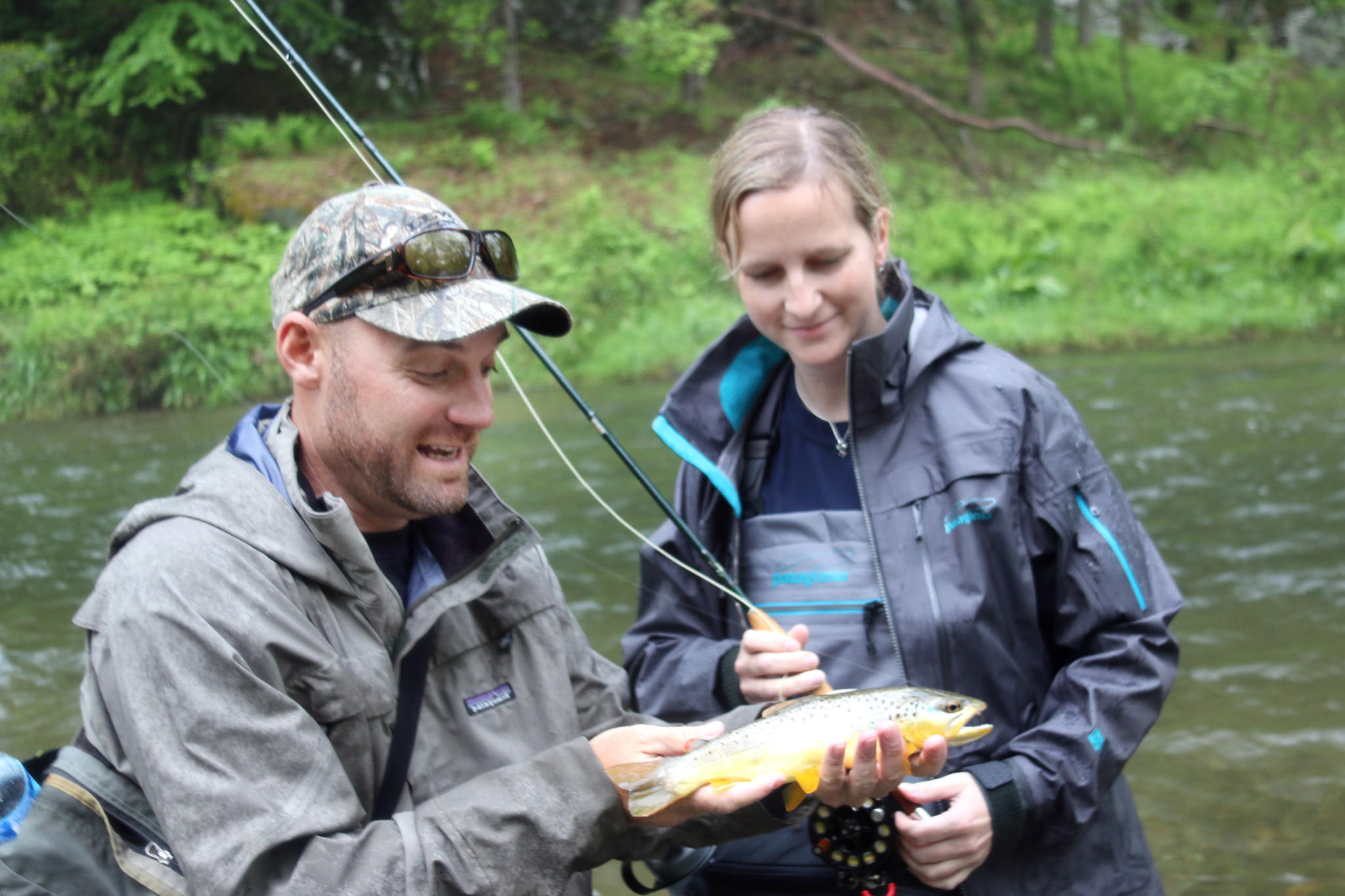 Jeff Lewatowski and Jennie Lindqvist with a brown trout Jennie caught. Lewatowski lives in Havre de Grace and guides fishing trips around the state.