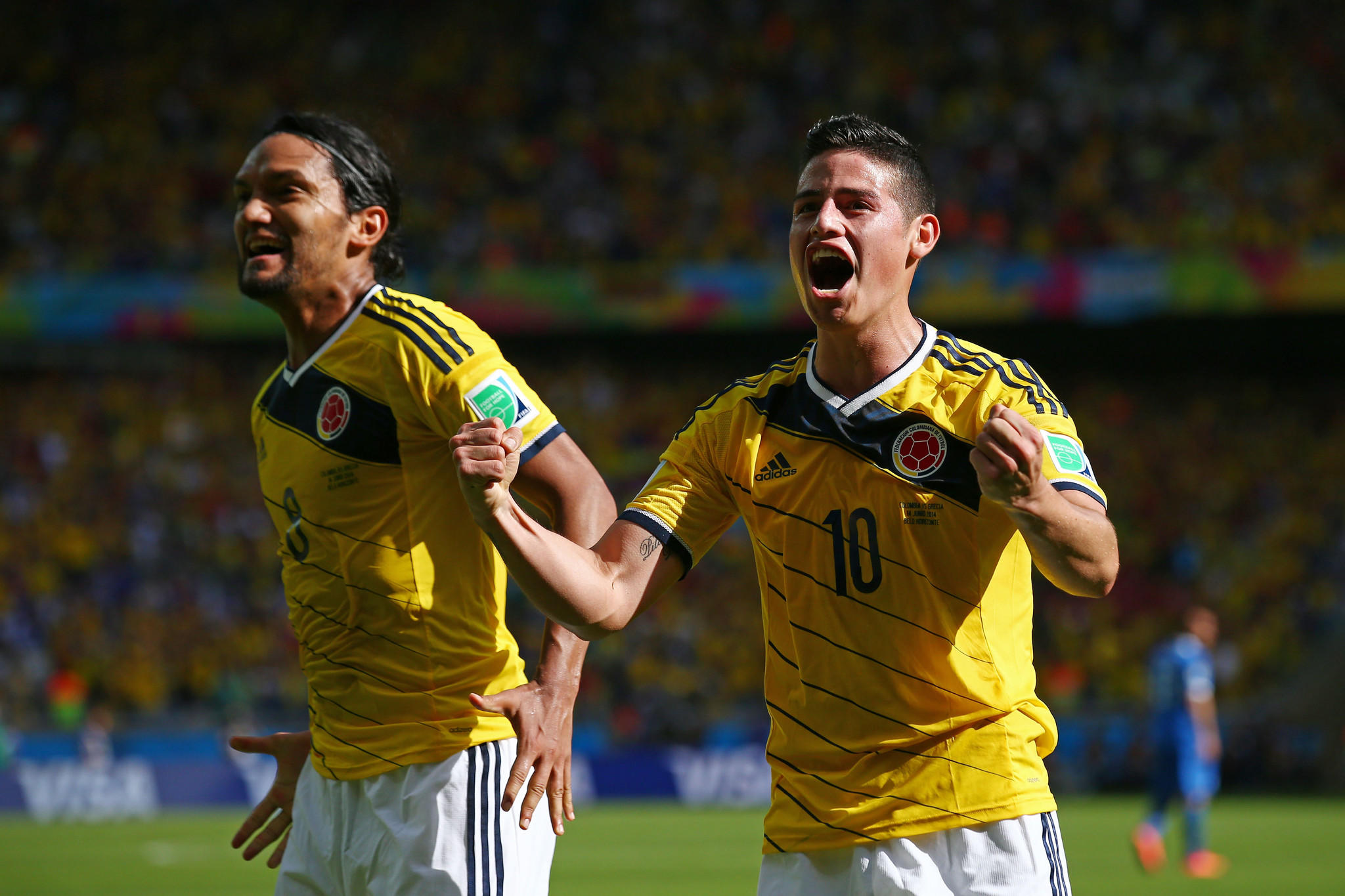 Abel Aguilar and James Rodriguez of Colombia celebrate