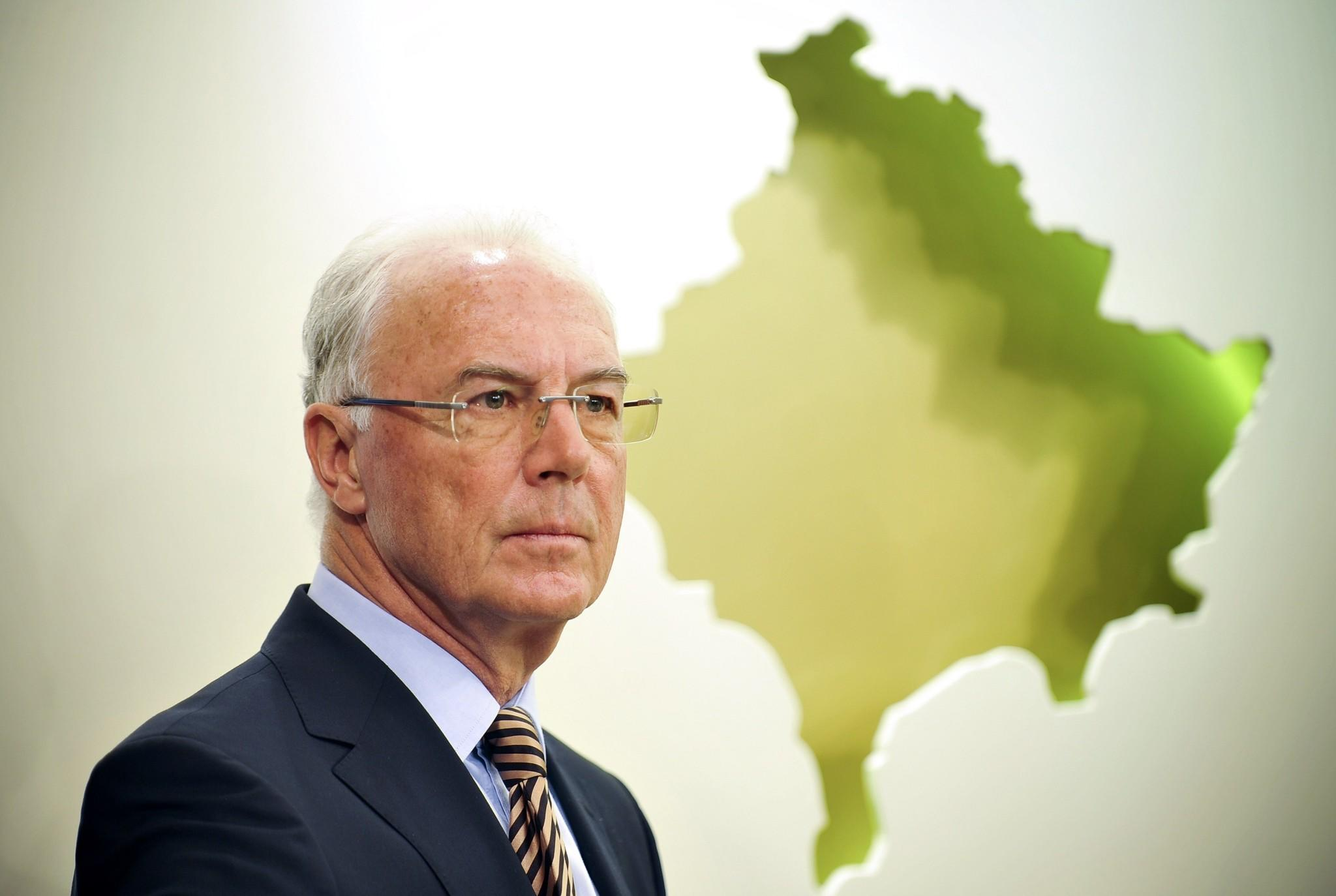 A file picture taken in Pristina on March 4, 2011 shows German football legend and FIFA executive committee member Franz Beckenbauer giving a press conference. FIFA banned German football legend Franz Beckenbauer from any football-related activity for 90 days on June 13, 2014, after he refused to speak to an inquiry into allegations that Qatar paid bribes to secure votes for its 2022 World Cup bid.