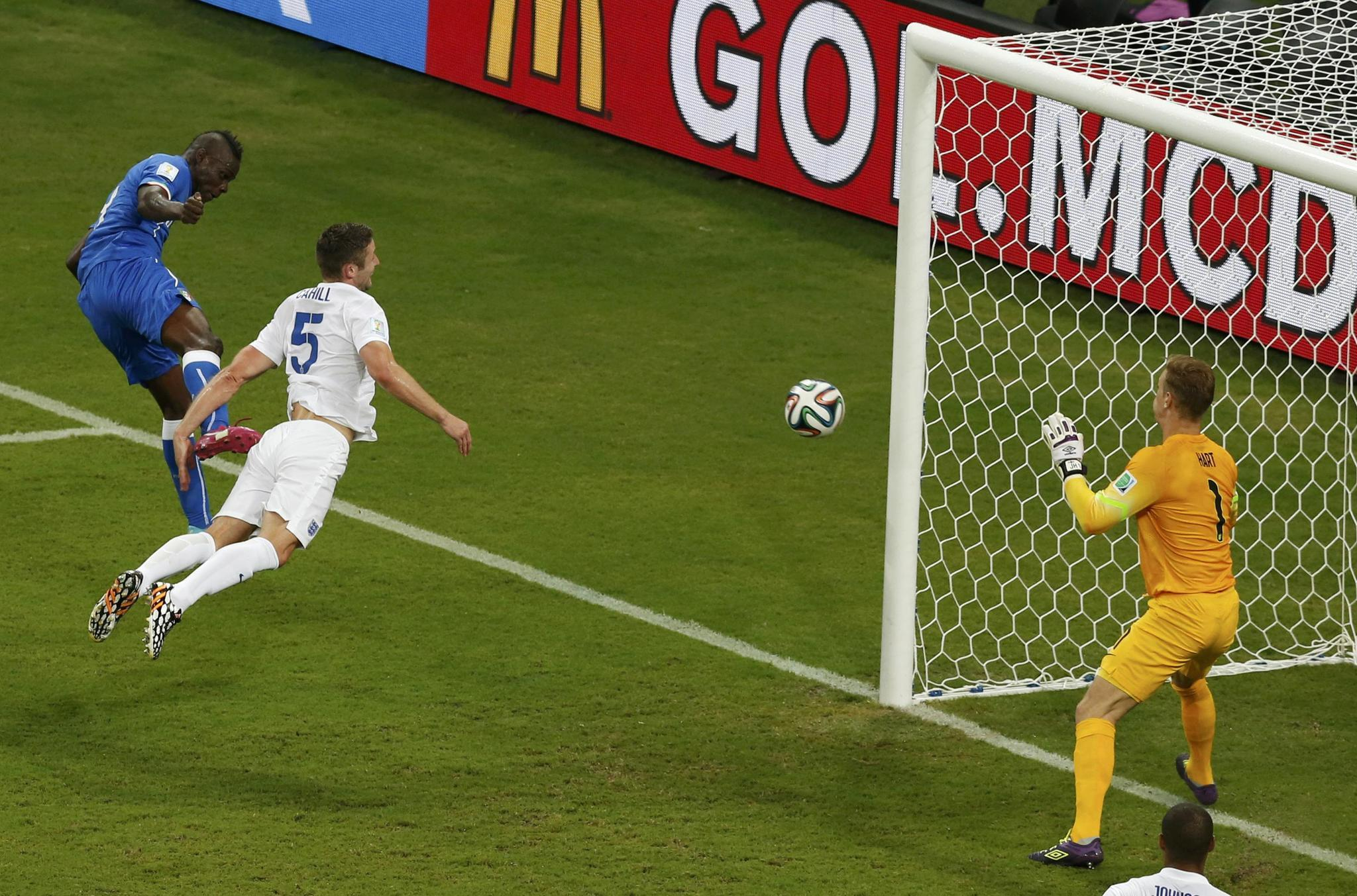 Italy's Mario Balotelli scores against England.
