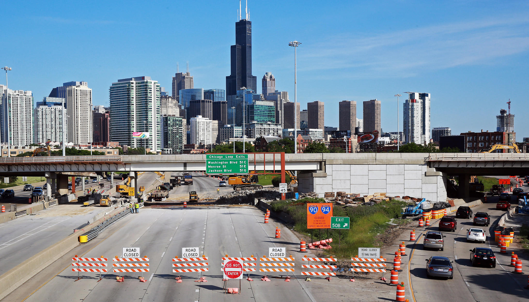 Inbound Kennedy Expressway traffic is diverted onto the Ohio Street off ramp as debris from the Ontario feeder ramp demolition is cleared.