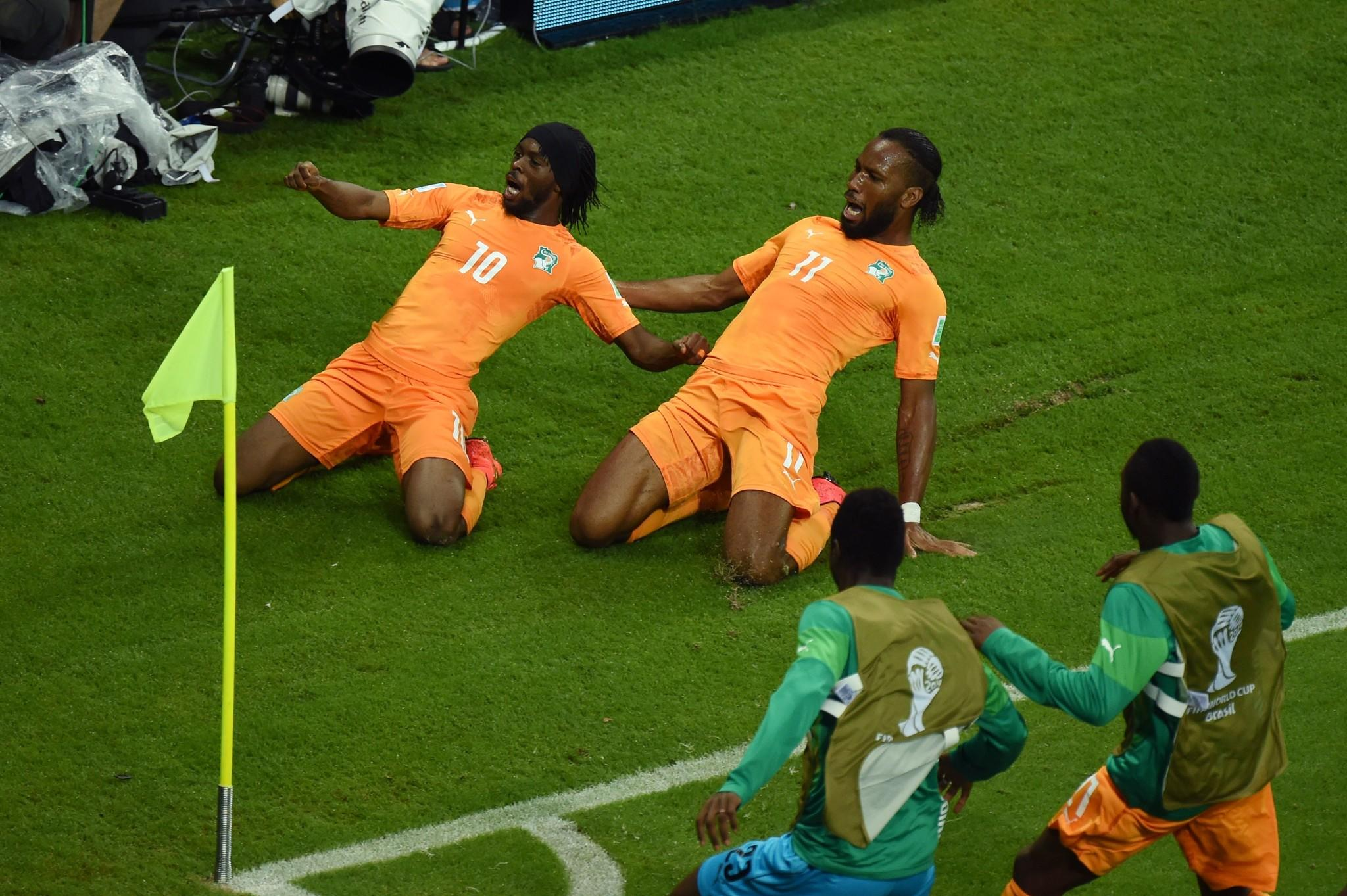 Gervinho of the Ivory Coast (L) celebrates scoring his team's second goal with teammate Didier Drogba.