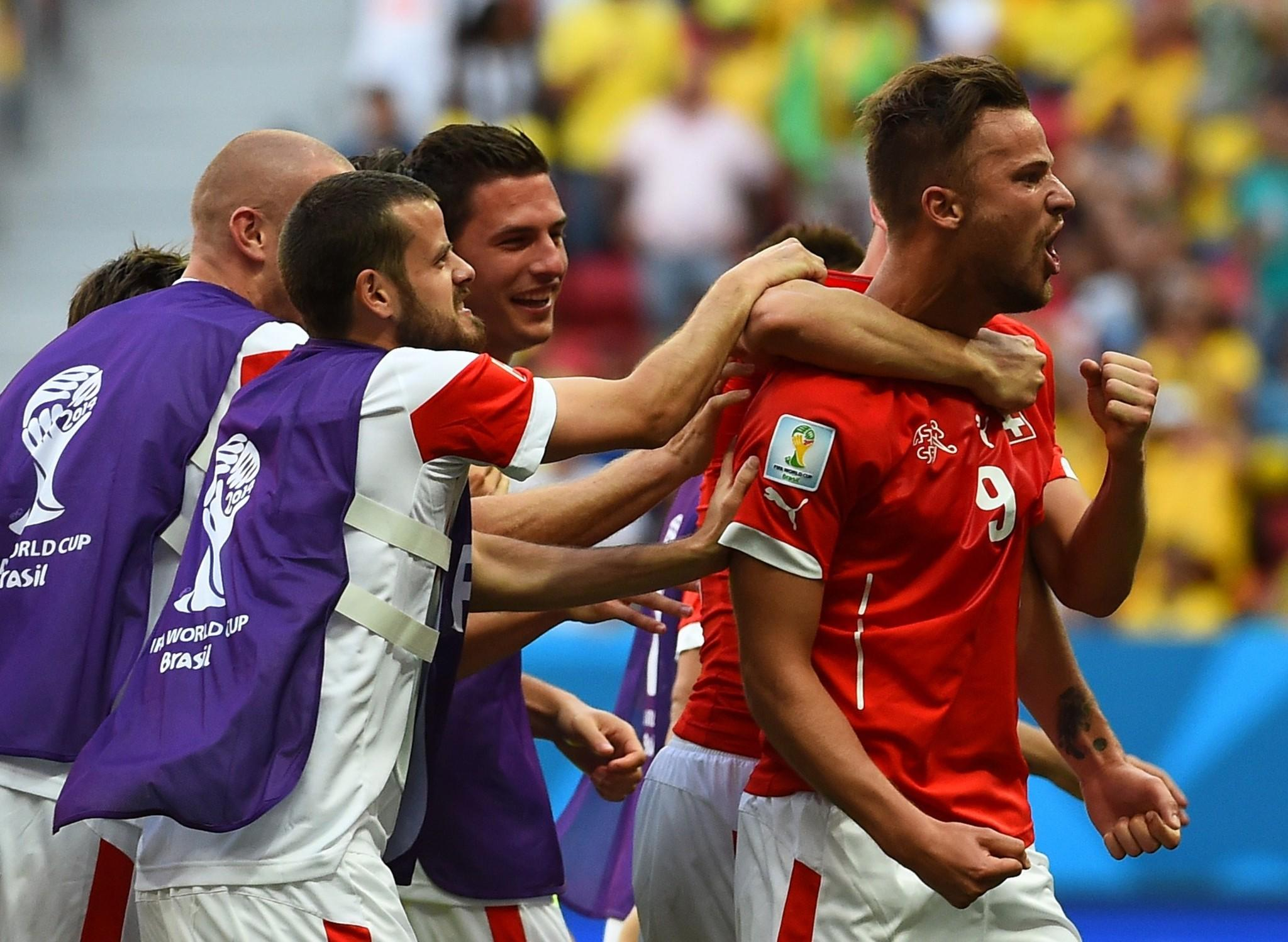 Switzerland's forward Haris Seferovic (right) celebrates after scoring Sunday.