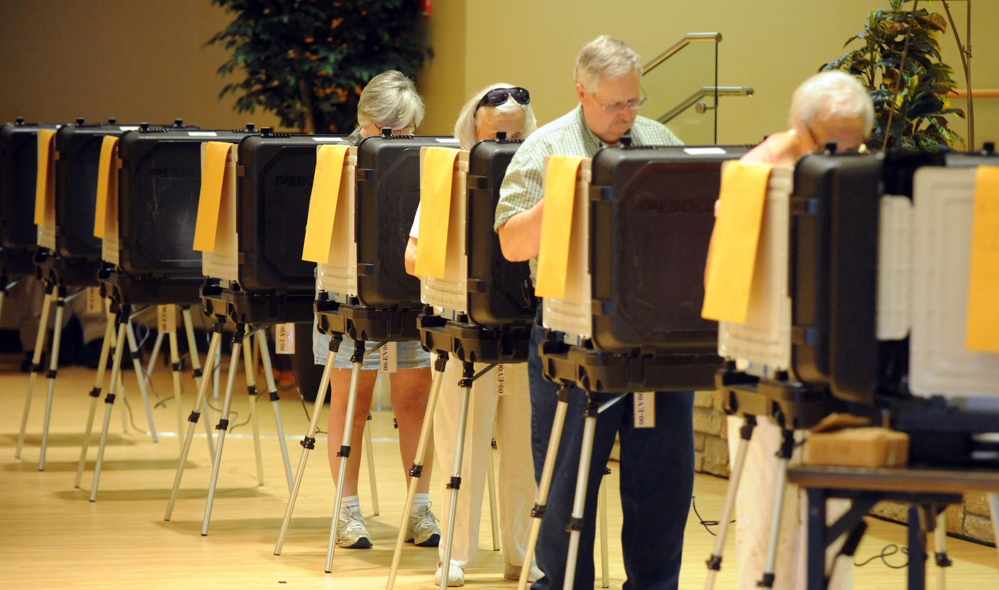 Voters cast their ballots during early voting at the Laurel-Beltsville Senior Activity Center on Friday, June 13.
