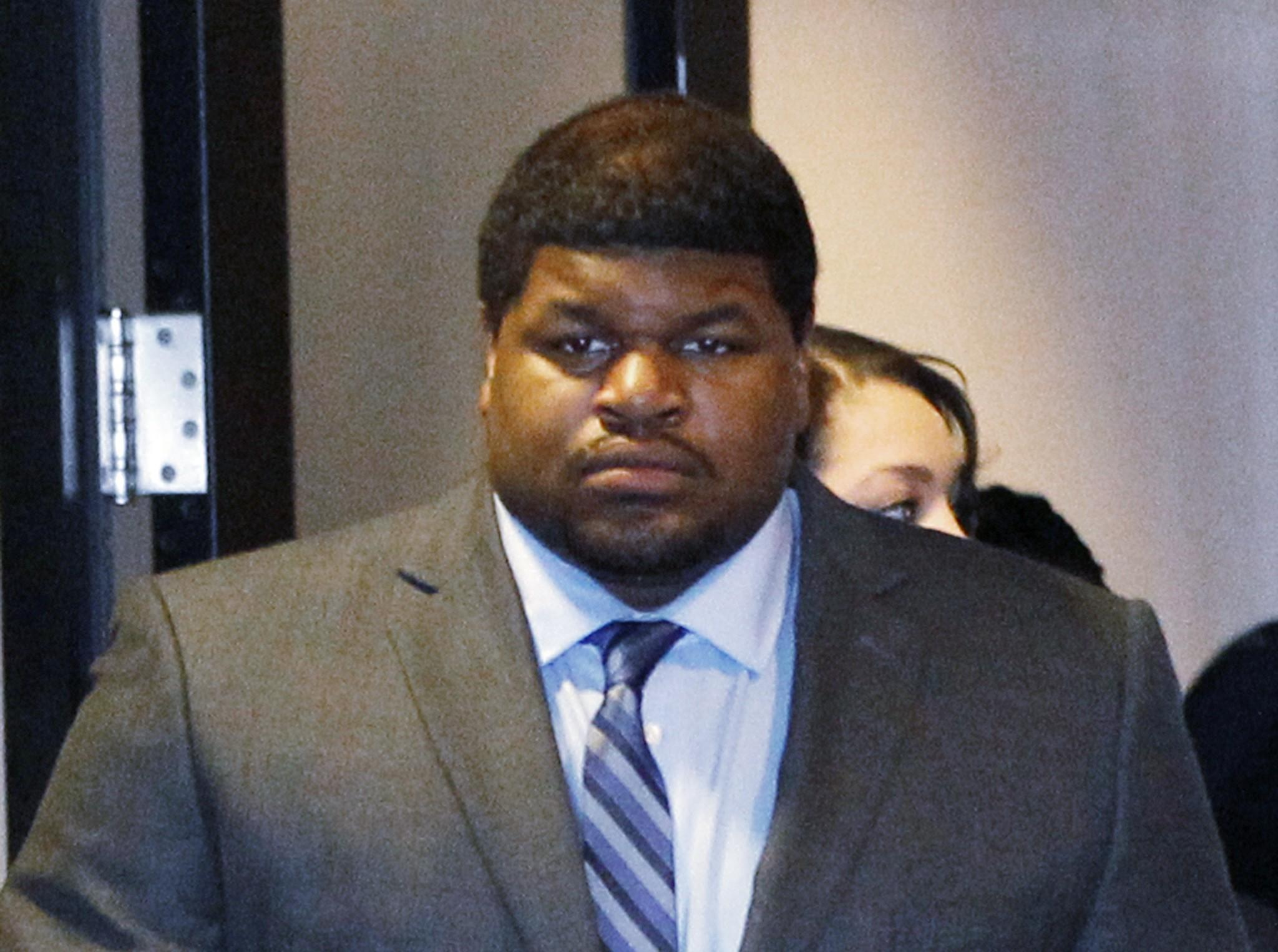 Former Cowboys player Josh Brent enters the courtroom in Dallas, Texas in this file photo taken January 14, 2014. A jury found Brent guilty of intoxication manslaughter charges on Wednesday, after he crashed his car, killing his friend and teammate Jerry Brown in 2012.