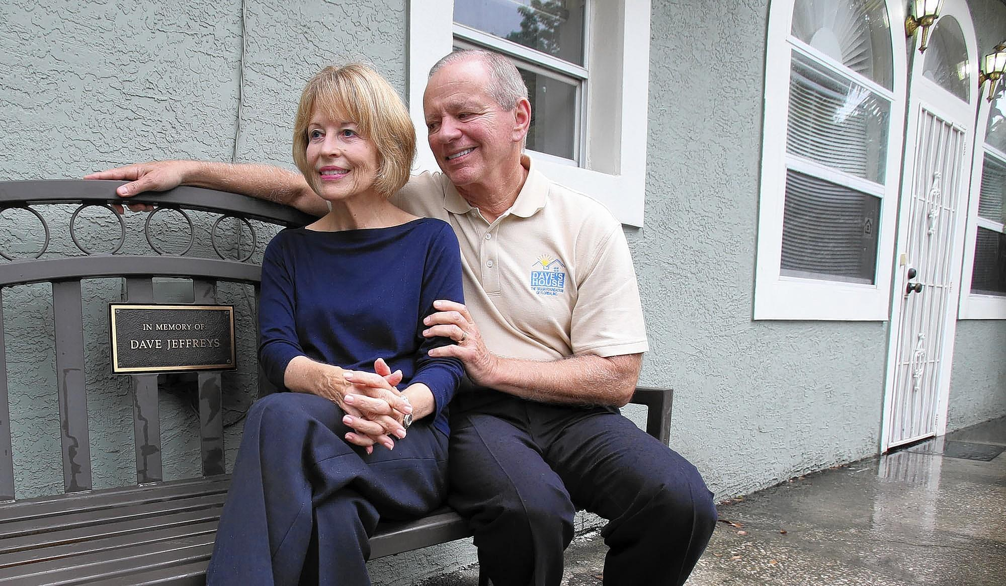 Lin and Ron Wilensky, co-founders of Dave's House, sit on a bench in memory of Lin's brother, who suffered from schizophrenia.