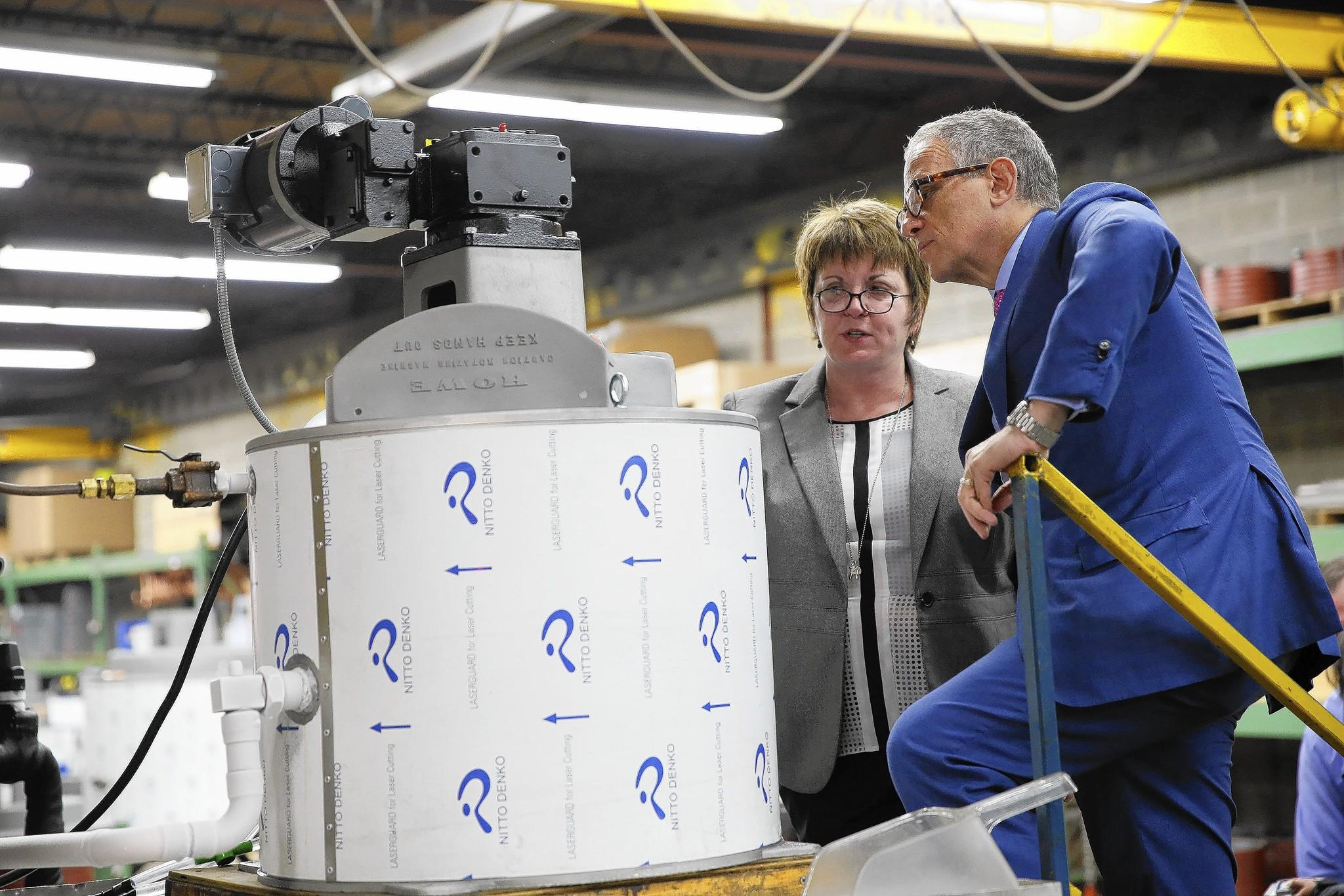U.S. Export-Import Bank chief Fred Hochberg visits Mary Howe, whose Chicago firm makes flake-ice machines. The bank aided her firm when it sought a loan after clients wanted more time to pay.