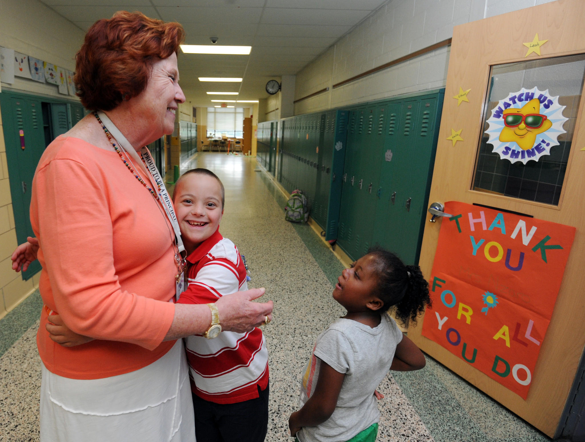 Susan Errichiello, the retiring principal of Belvedere Elementary School in Anne Arundel County, gets a hug from Ethan Baumunk, 10, as Noelle Gunder, 11, watches last week.