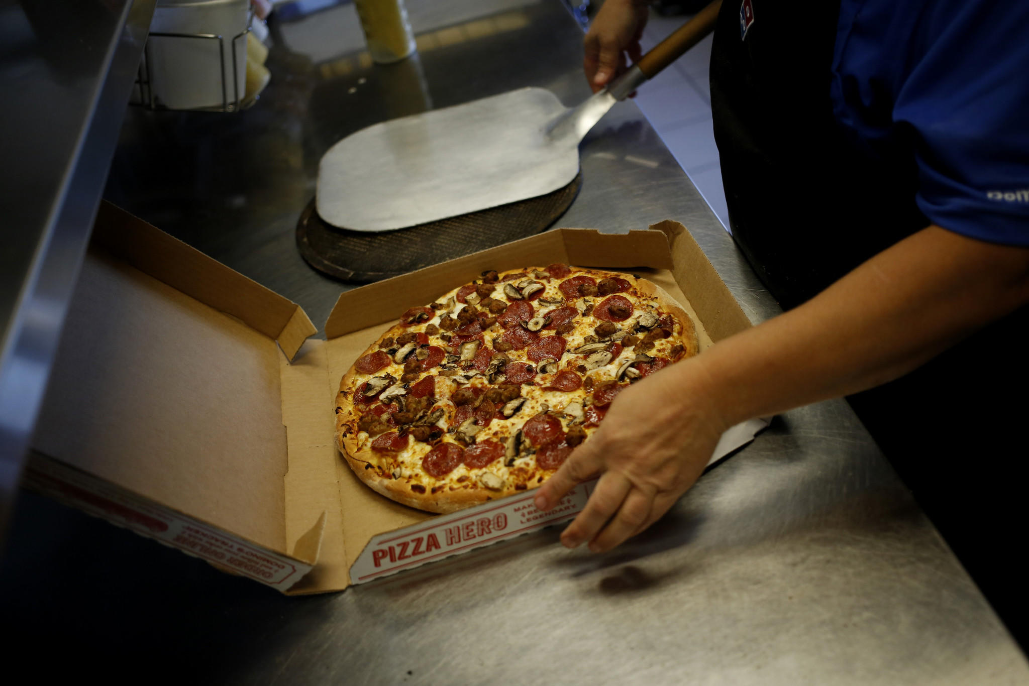 A Domino's worker boxes a pizza in Murray, Kentucky on Oct. 24, 2013.