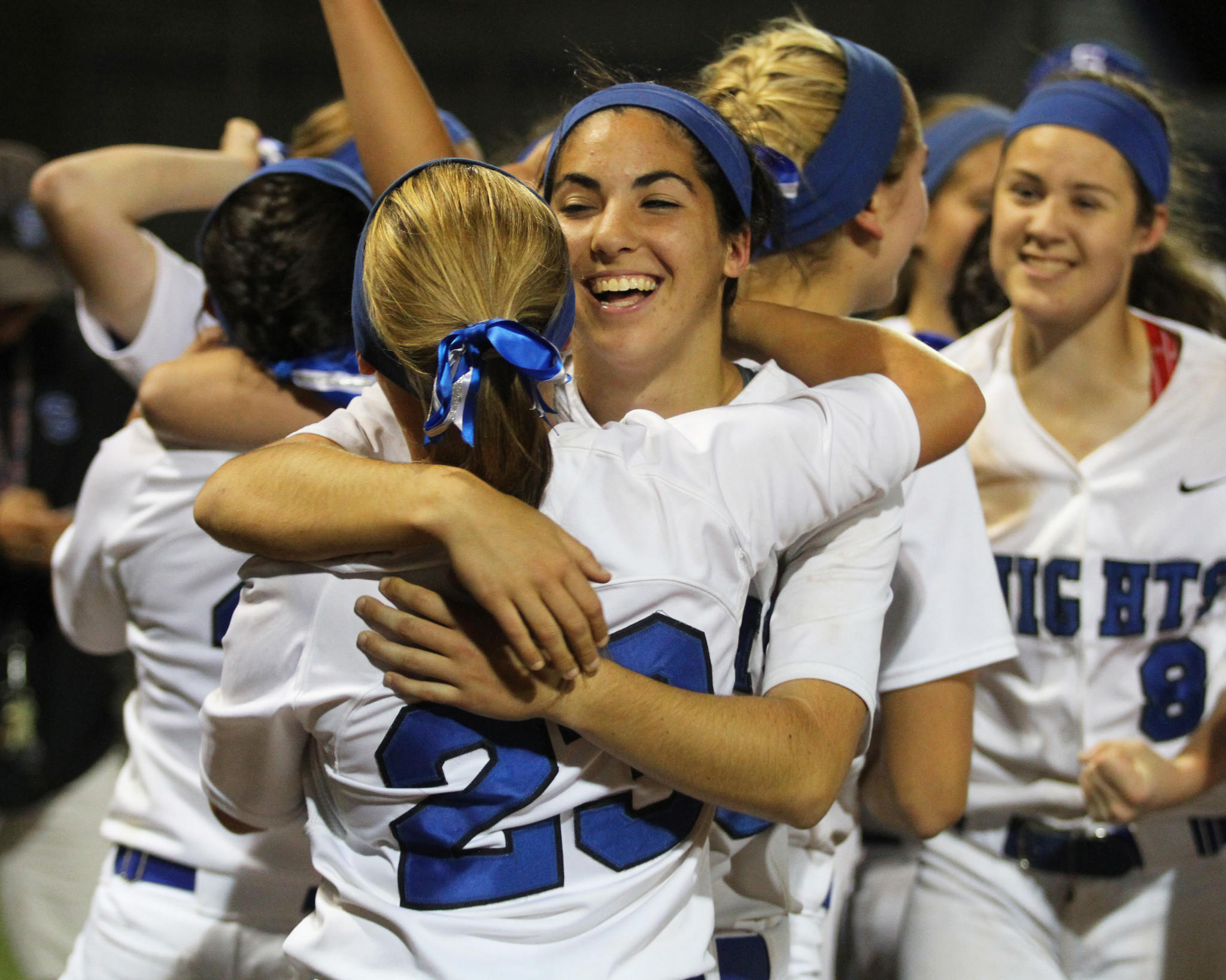 The Southington High softball team celebrates a 1-0, 15-inning win over Amity in the Class LL championship on Saturday night.