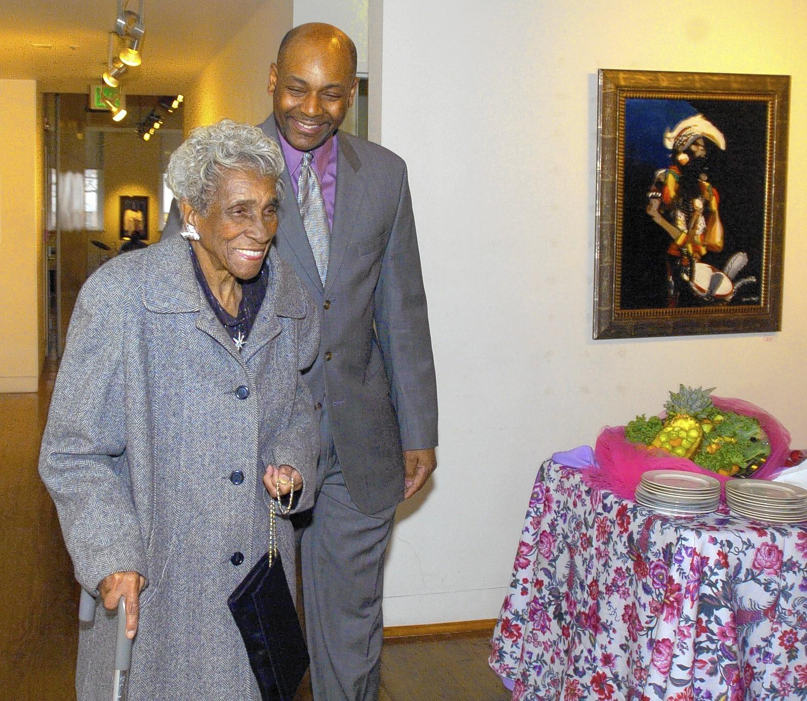 In 2006, former students of Dorothy Thomas, then 90, surprised her with a tribute luncheon at the Eubie Blake Center for her dedication as a teacher for 20 years at Windsor Hills Elementary School. A surpised Ms. Thomas, left, is escorted by Ray Nelson, right, her student from 1971, as she arrives for the luncheon.