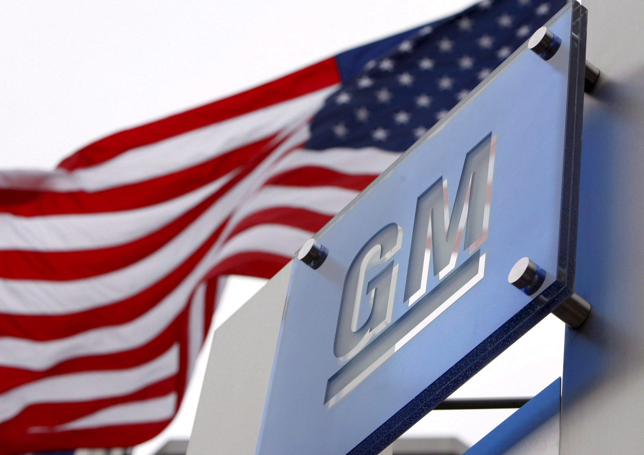 Flags fly outside the General Motors World Headquarters in the Renaissance Center in Detroit.