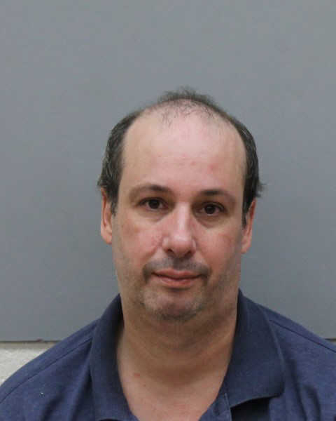 A University of Connecticut chemistry professor who is already on probation for prior convictions was charged Saturday by Vernon police with drunken driving and assault on a police officer.Read The Story  HereCheck Out More Mugs In The News  Here