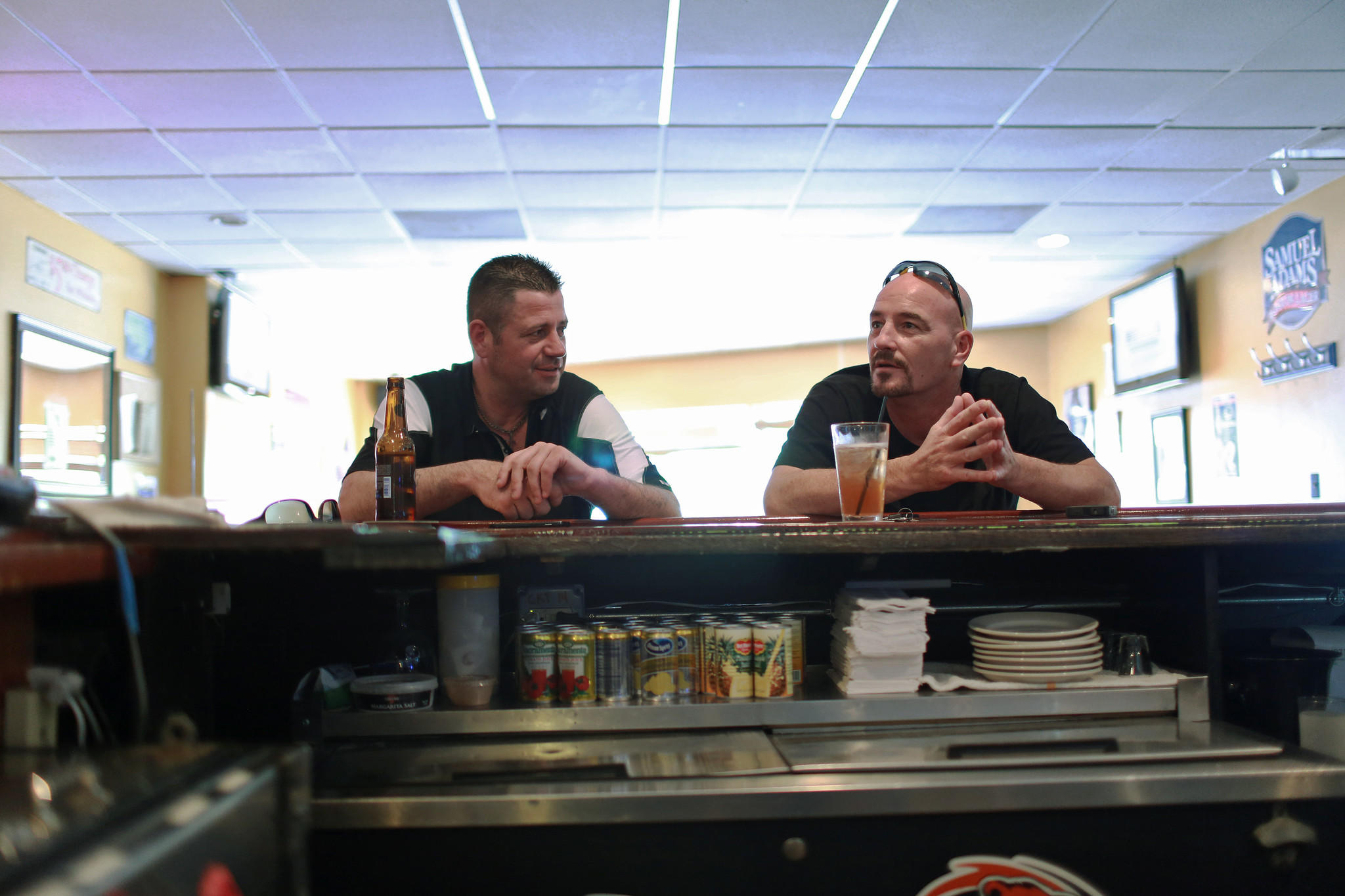Brian Jones, left, and his older brother John Sawicki talk Friday at Eddie's Restaurant and Lounge in Arlington Heights. Jones, an Iraq War veteran, believes that the U.S. military pulled out of that country too soon, but that it's too late to go back now.