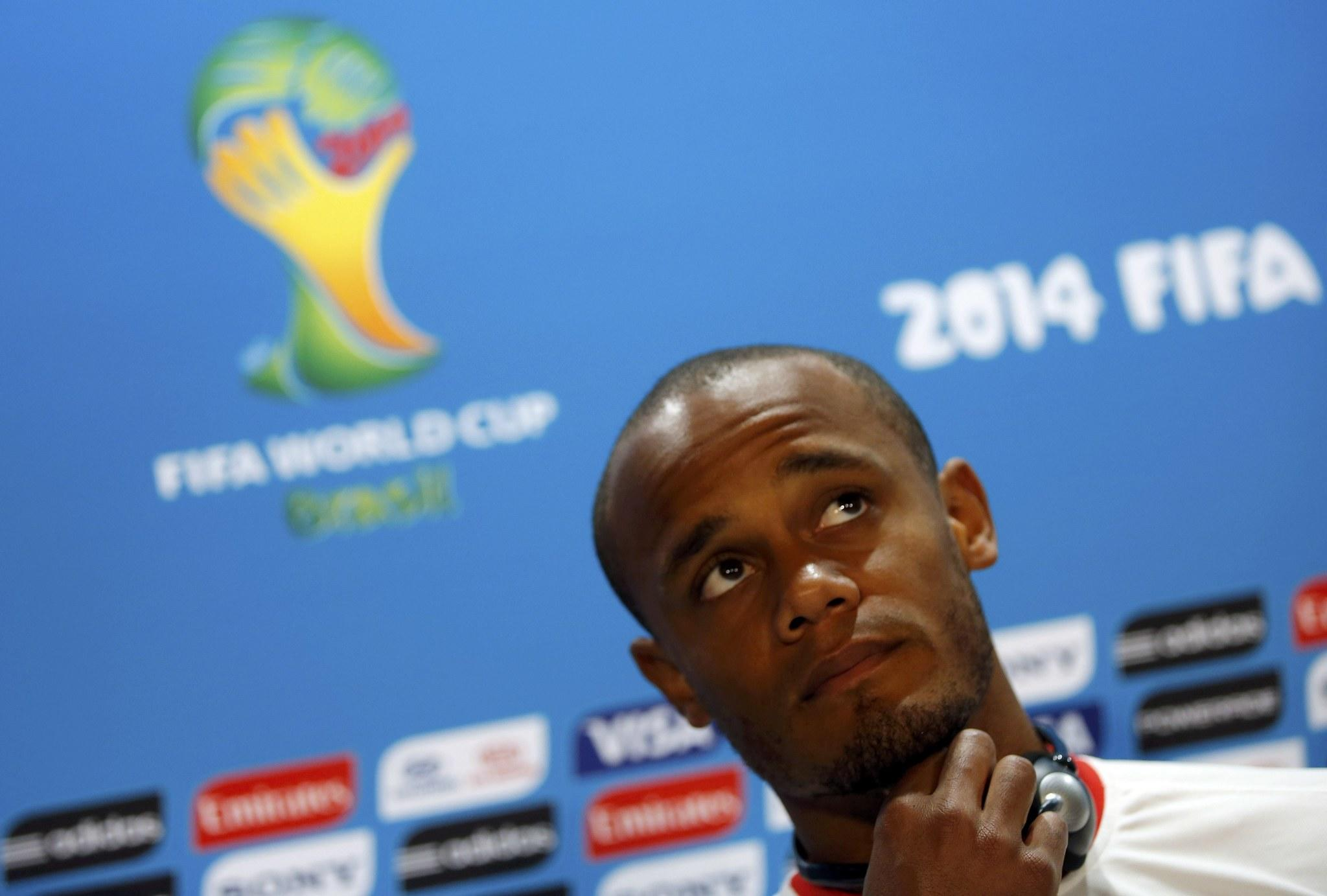 Belgium's national soccer player Vincent Kompany attends a news conference before a training session at Mineirao stadium in Belo Horizonte on Monday. Belgium will face Algeria in their first 2014 World Cup Group H soccer match on Tuesday.