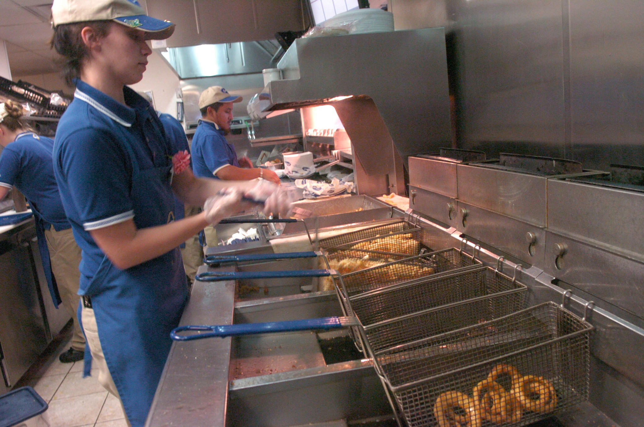 Employee Amy Rogers operates the frying vats at the Culver's franchise in Pleasant Prairie, Wis.