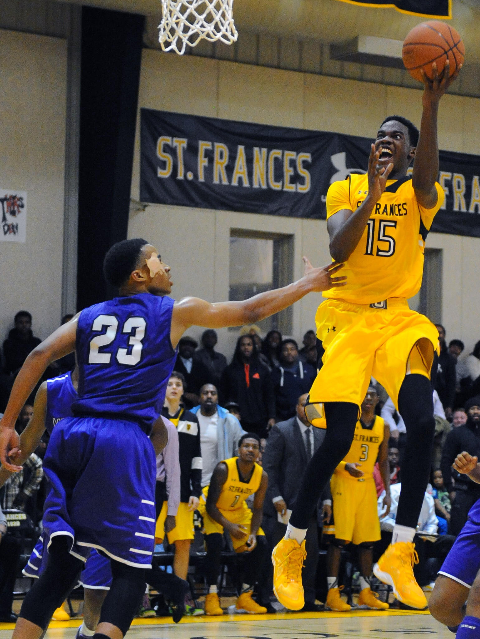 St. Frances' Dwayne Morgan, right, shoots over Mount St. Joe's Phil Booth, Jr., in the third quarter.