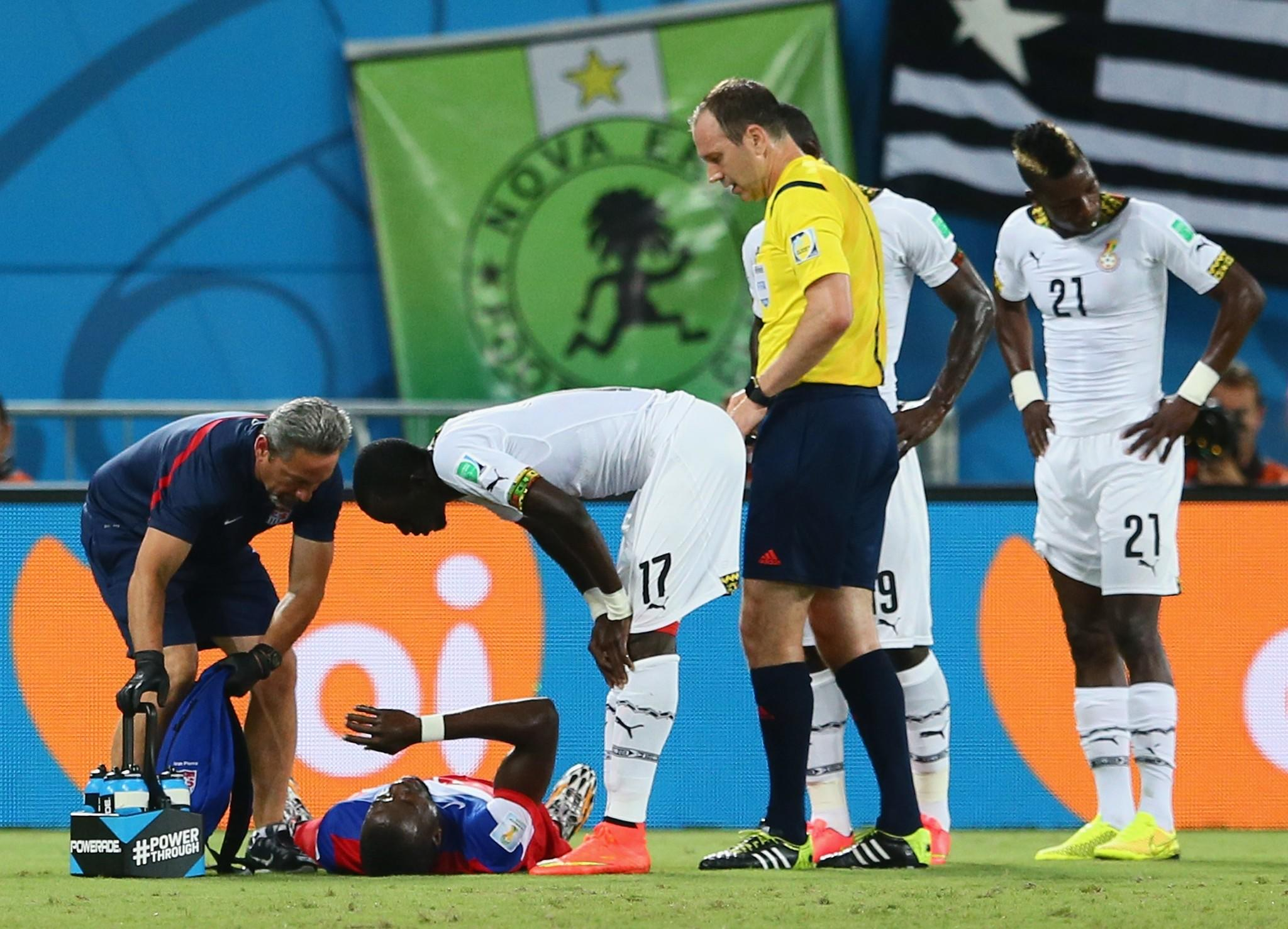 NATAL, BRAZIL - JUNE 16: An injured Jozy Altidore of the United States lies on the field as Mohammed Rabiu of Ghana stands over during the 2014 FIFA World Cup Brazil Group G match between Ghana and the United States at Estadio das Dunas on June 16, 2014 in Natal, Brazil. (Photo by Kevin C. Cox/Getty Images) ORG XMIT: 491717955