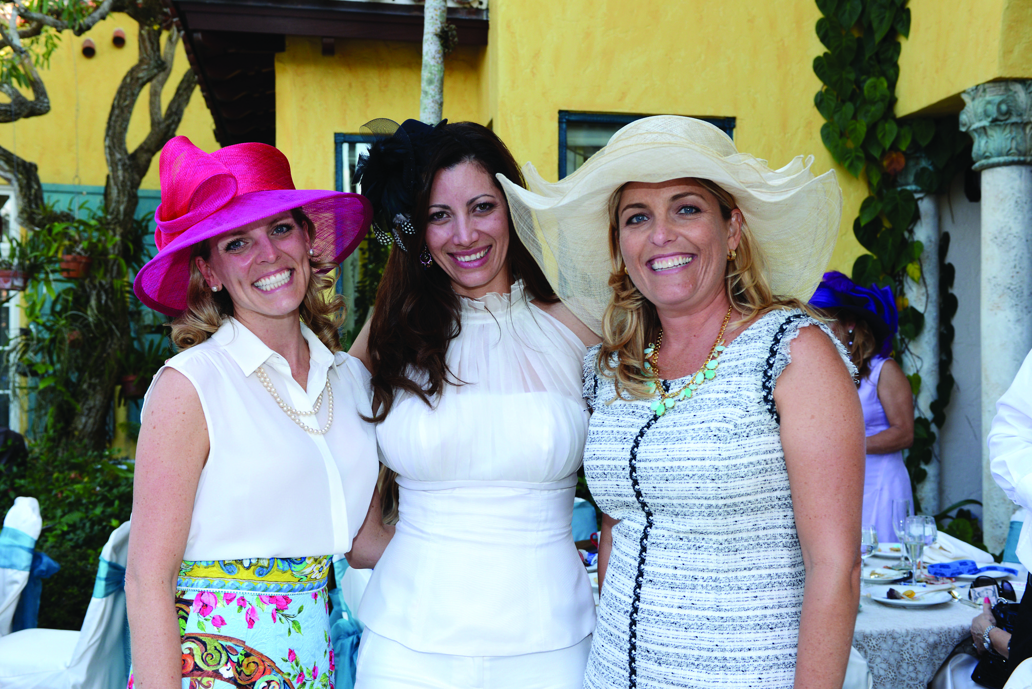 "Society Scene photos - Jeannie Hudson, left, Sohely van Woerkom and Valerie Harvey recently donned fashionable hats for ""Tea by the Sea,"" a PAWS event to benefit the Humane Society of Broward County. The fundraiser took place at the home of Wayne and Marti Huizenga and raised $44,000."