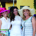 "Jeannie Hudson, left, Sohely van Woerkom and Valerie Harvey recently donned fashionable hats for ""Tea by the Sea,"" a PAWS event to benefit the Humane Society of Broward County. The fundraiser took place at the home of Wayne and Marti Huizenga and raised $44,000."