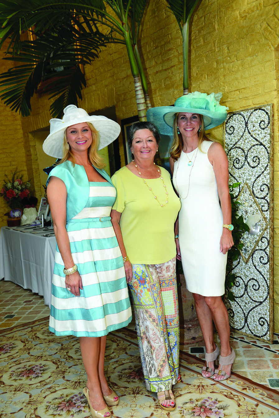 "Society Scene photos - Michelle Russo-Matak, left, Marti Huizenga and Jamie Stiles recently supported ""Tea by the Sea,"" a PAWS event to benefit the Humane Society of Broward County. The fundraiser took place at the home of Wayne and Marti Huizenga and raised $44,000."