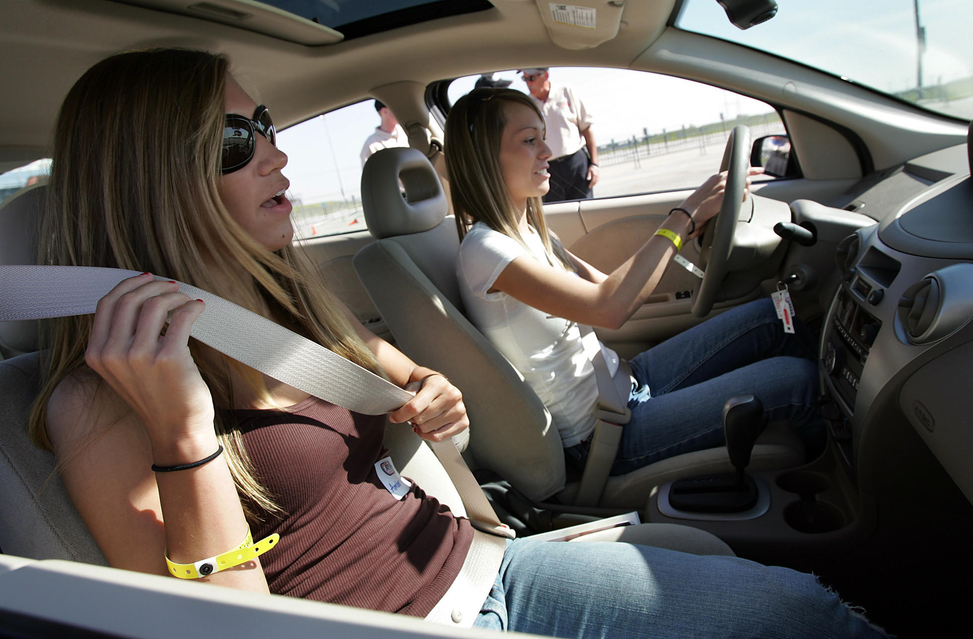 """Amber Crutchfield 18, (l to r) and Megan Nolan 18, belt up and get ready to head out onto the course. Over a dozen high school students took part in a pilot teen safety driving program at Route 66 Raceway in Joliet, Il. Sponsored by the National Safety Council and the Richard Petty Driving Experience School, the students went through a number of hands on driving situations in this first """"Safety Training Awareness for Youth"""" (S.T.A.Y.) program."""