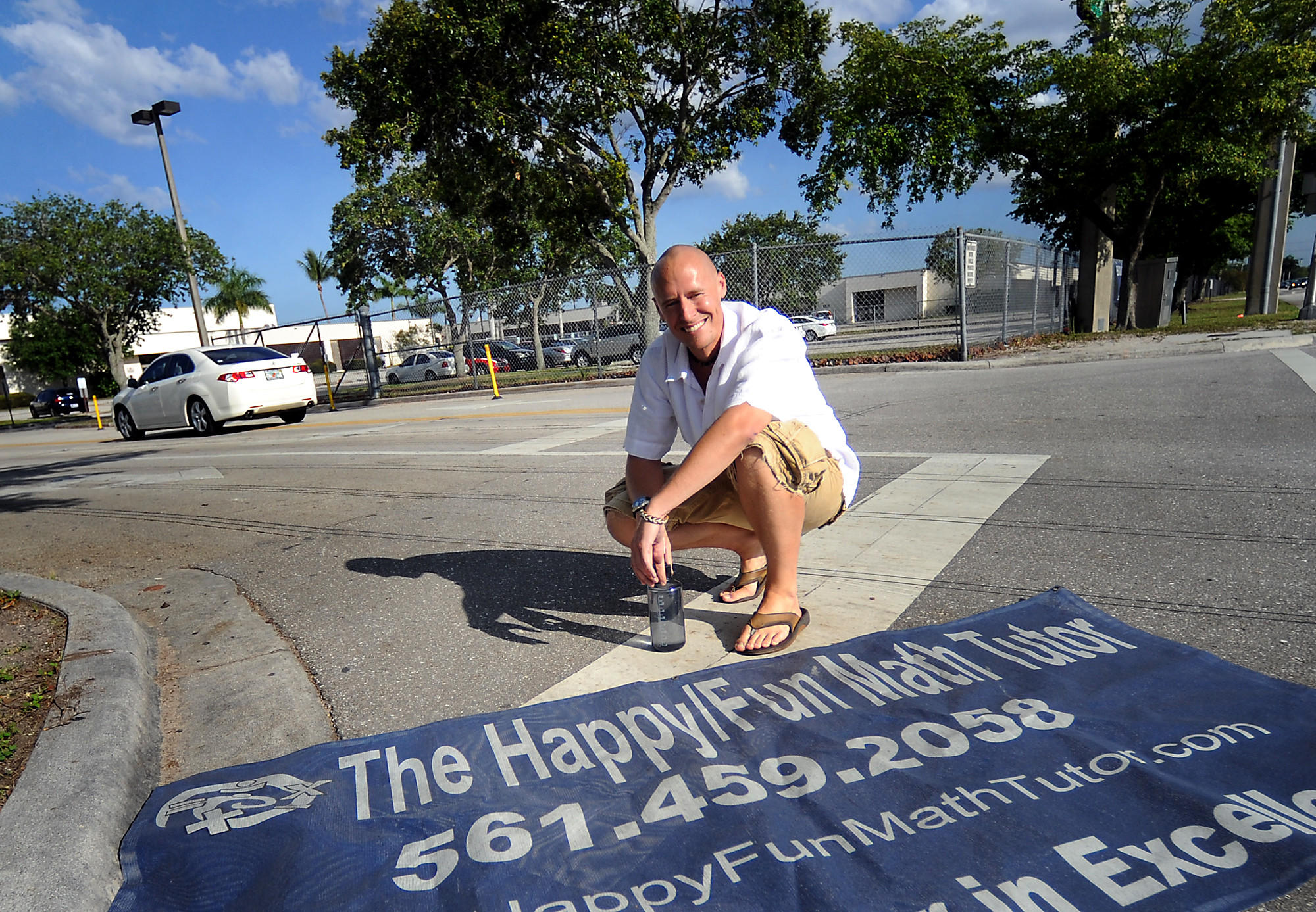 In a 2013 photo, Dave Mech displays his sign that was taken down by three Boca Raton schools after revelations that he had worked in porn. Mech is now running fora seat on the School Board
