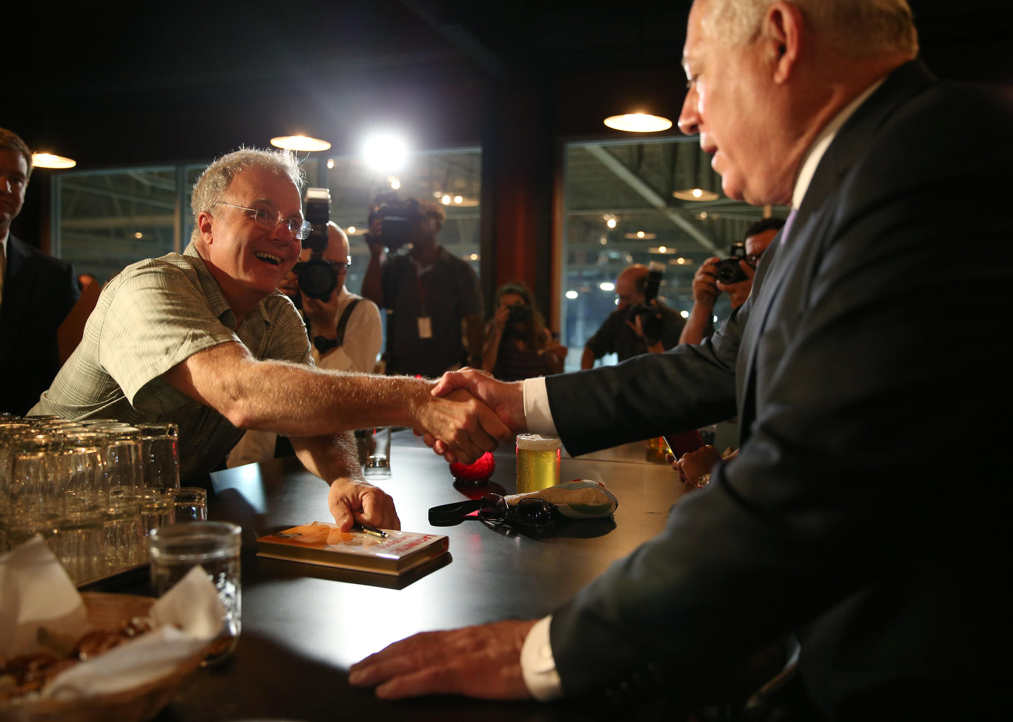 Tony Magee founder and CEO of Lagunitas Brewing Co. shakes hands with Gov. Pat Quinn, after signing a book for him, during a tour of the Lagunitas Taproom.