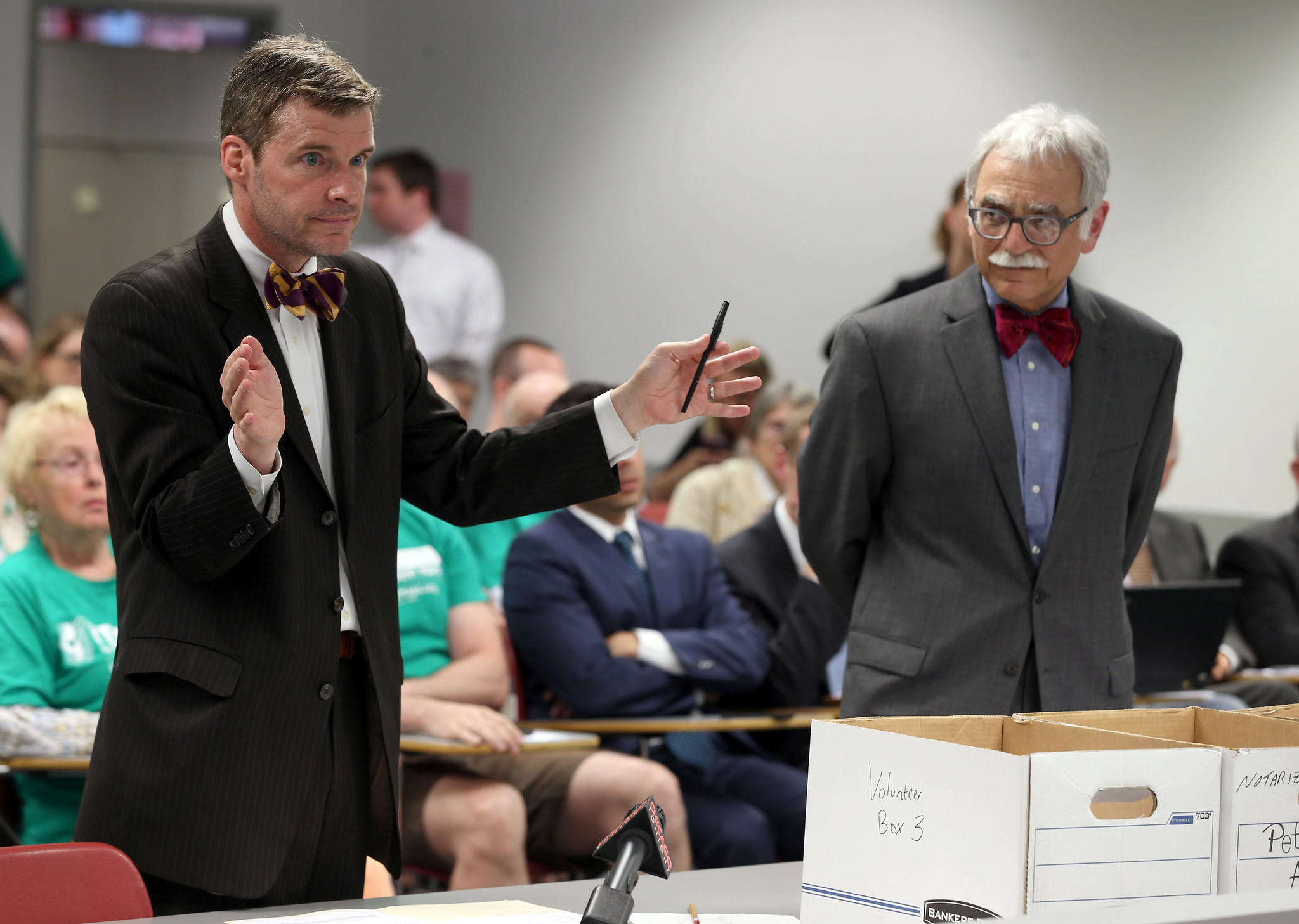 Attorneys Mike Kasper, left, and Michael Dorf argue before the Illinois State Election Board.